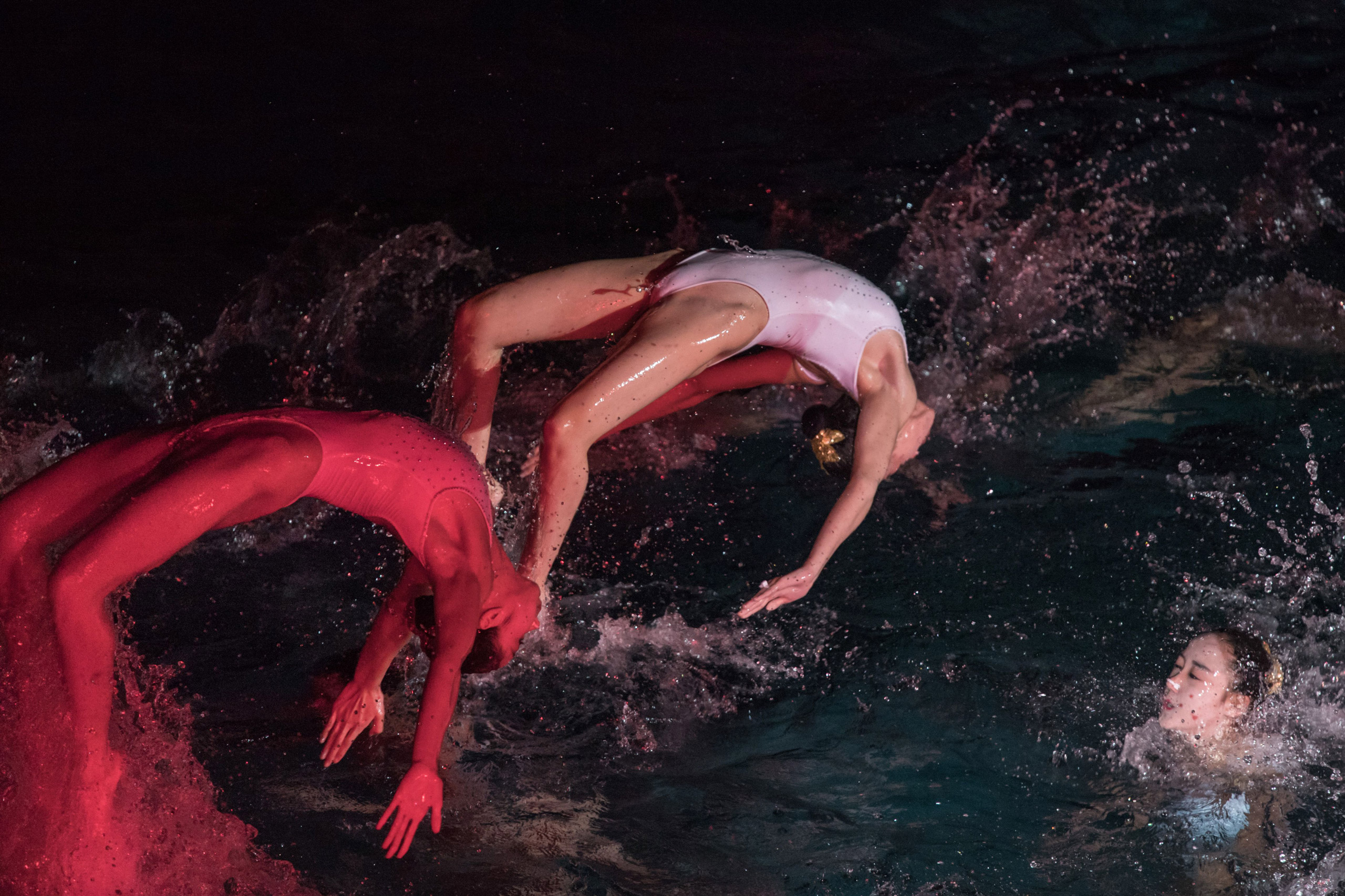 Swimmers perform in a synchronized swimming gala event in Pyongyang on Feb. 15, 2017. The gala was part of a series of events being held to celebrate the 75th anniversary of the birth of late North Korean leader Kim Jong-Il.