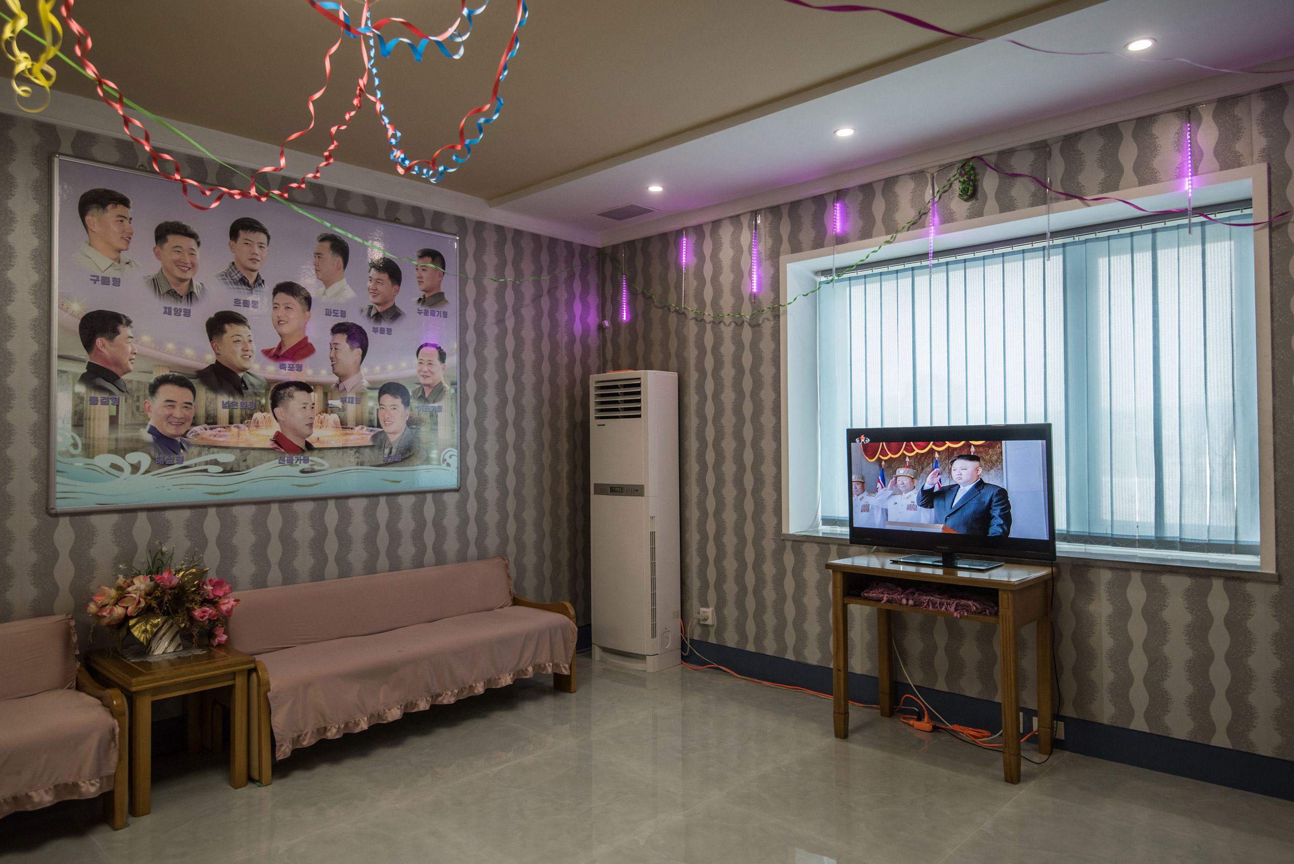 A television shows footage of North Korean leader Kim Jong-Un during a military parade at a barber shop inside a leisure centre during an organised tour for visiting foreign journalists, in Pyongyang on April 16, 2017.