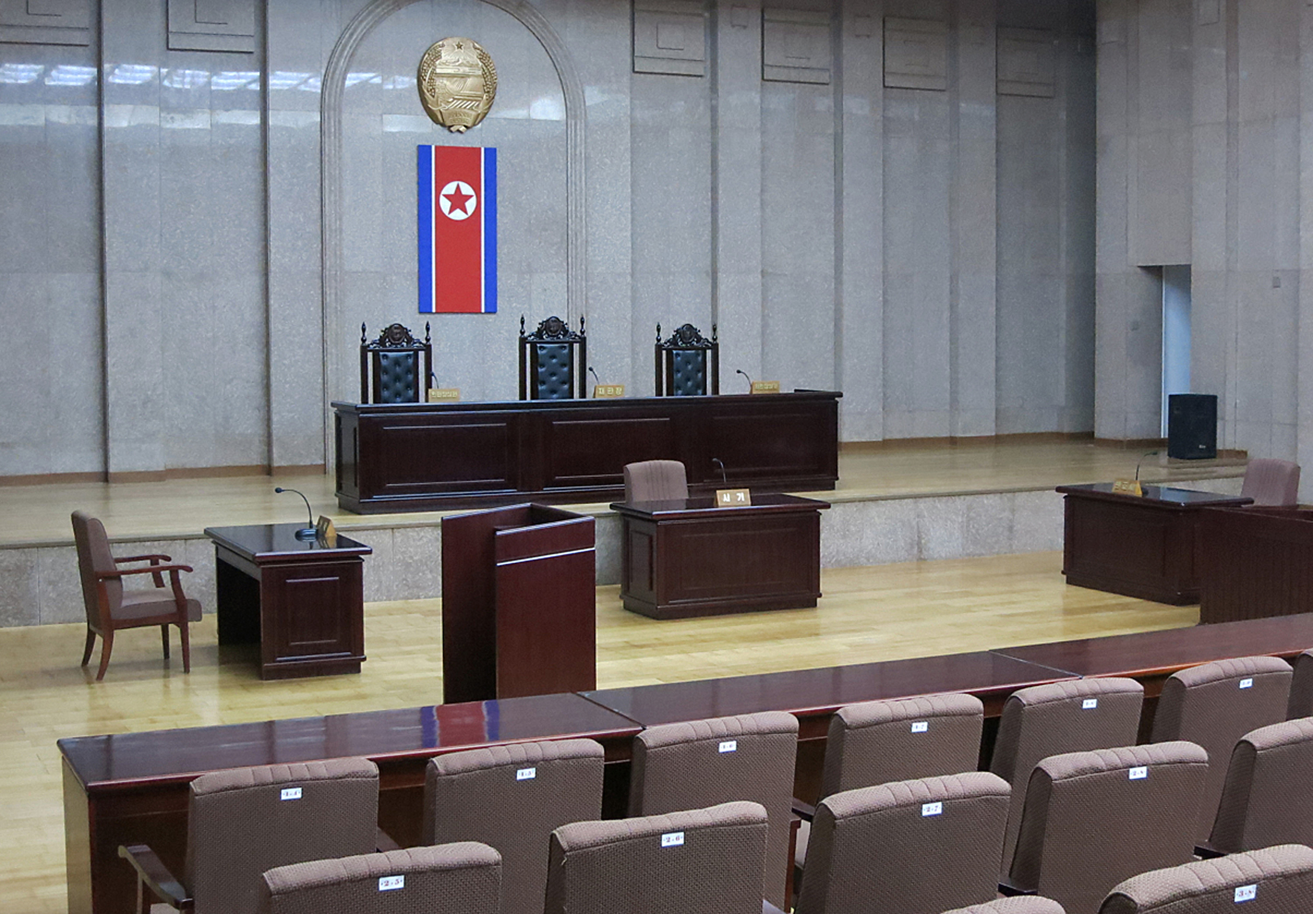 A North Korean flag hangs inside the interior of Pyongyang's Supreme Court in March 2013.