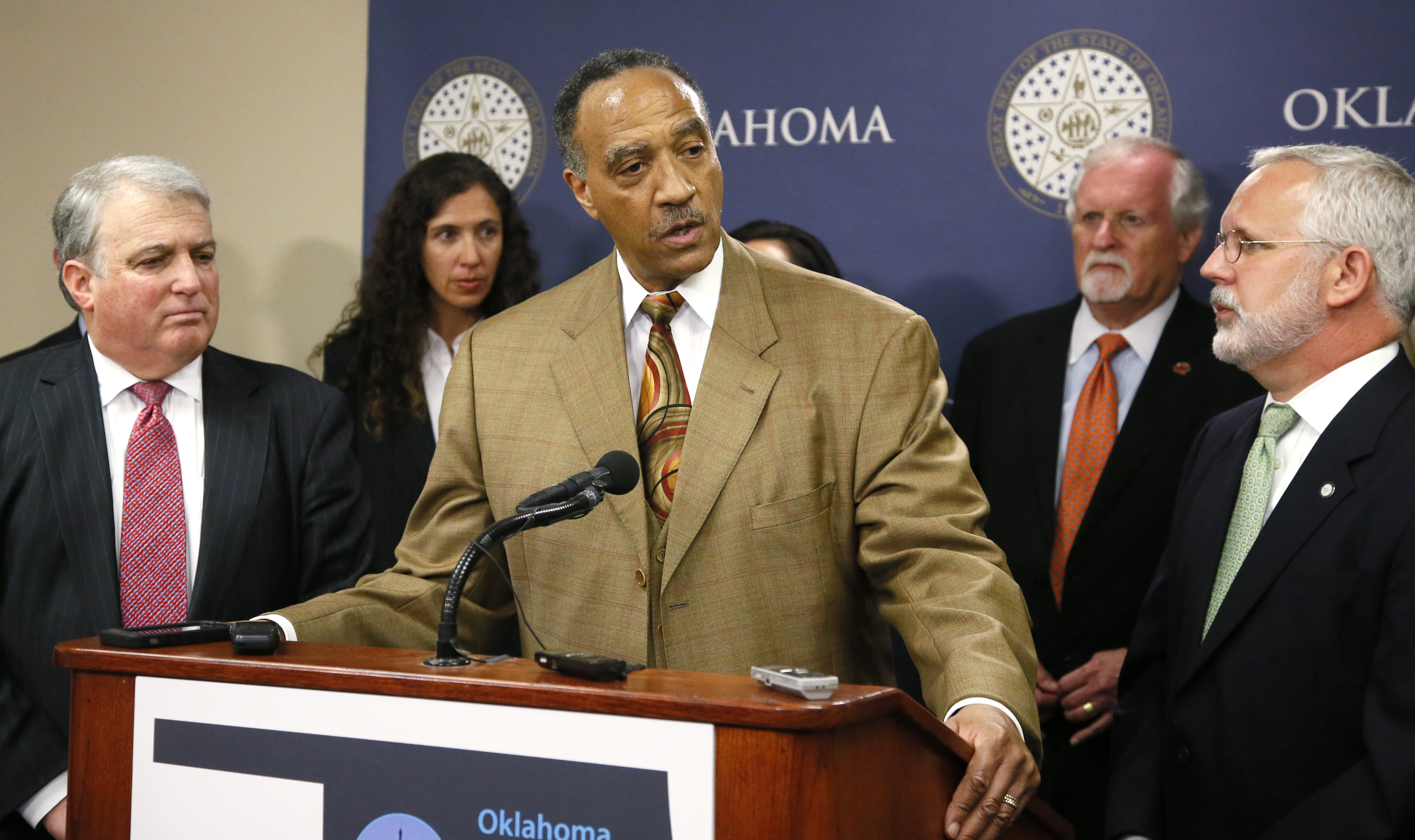 Robert H. Alexander, Jr., center, a member of the Oklahoma Death Penalty Review Commission, speaks during a news conference in Oklahoma City, Tuesday, April 25, 2017. The commission released a report that says the state should extend its moratorium on capital punishment. At left is Andy Lester and at right is former Oklahoma Gov. Brad Henry. (AP Photo/Sue Ogrocki)