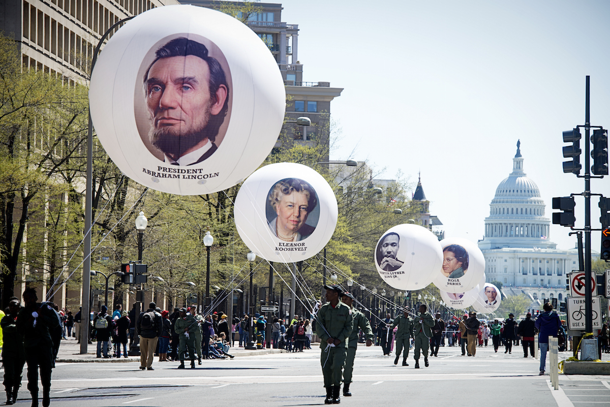 Balloons bearing the faces of people who are champions of civil rights, during the D.C. Emancipation Day parade in Washington, D.C. on April 16, 2014.
