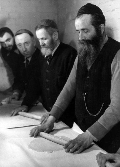 Orthodox Jewish refugees in the Mariendorf DP Camp bake Passover matzah using the shmurah flour provided by JDC. Berlin-Mariendorf, Germany, c. 1948. Photographer: Alois Bankhardt.
