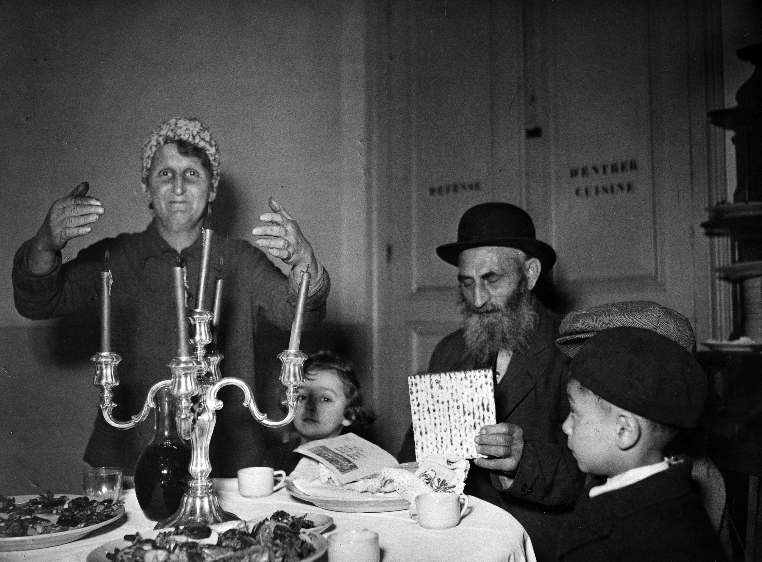 Two elderly occupants of a shelter for Jews transients in France at a seder. France, c.1947. Photographer unknown.