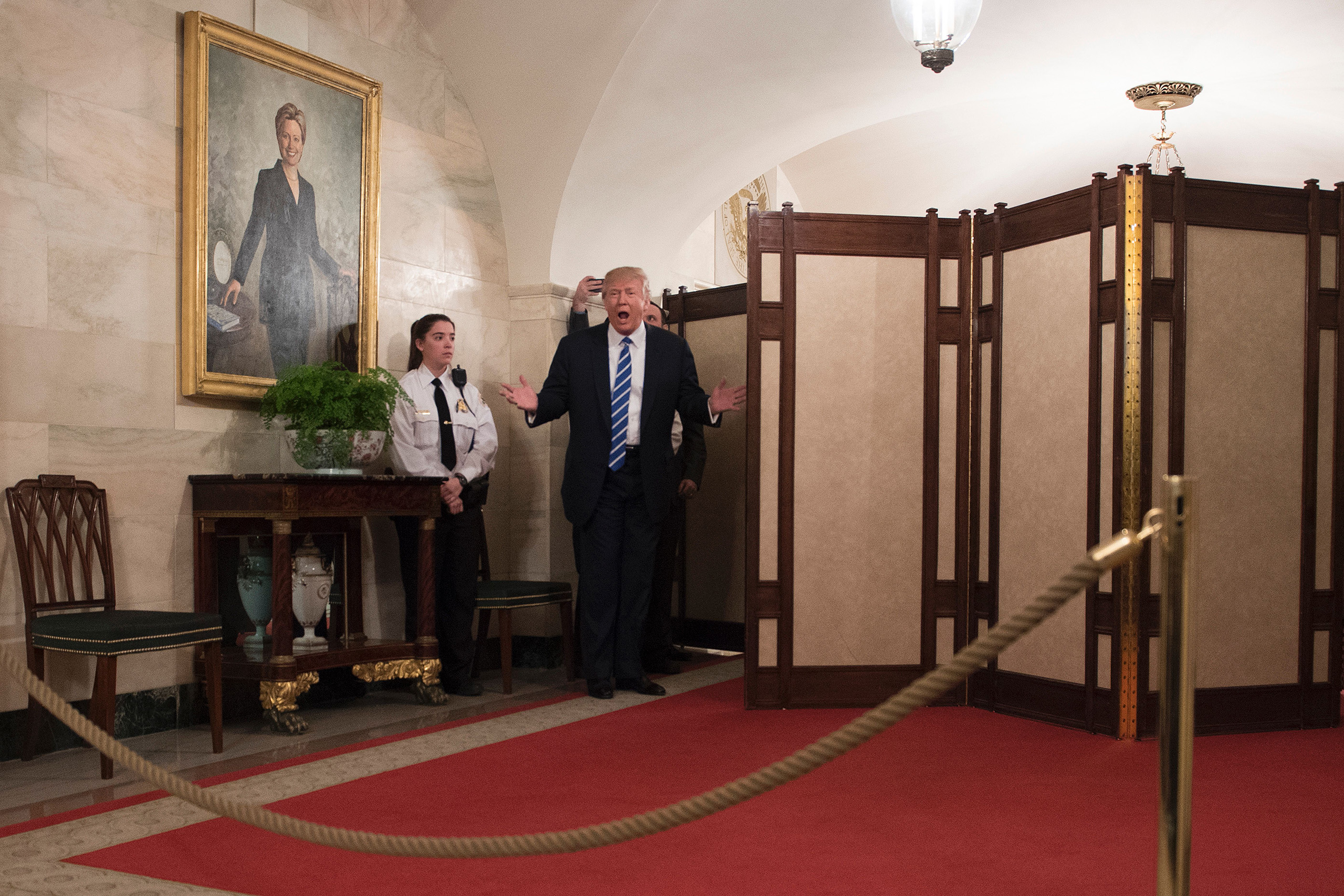 US President Donald Trump surprises visitors during the official reopening of public tours at the White House on March 7, 2017.