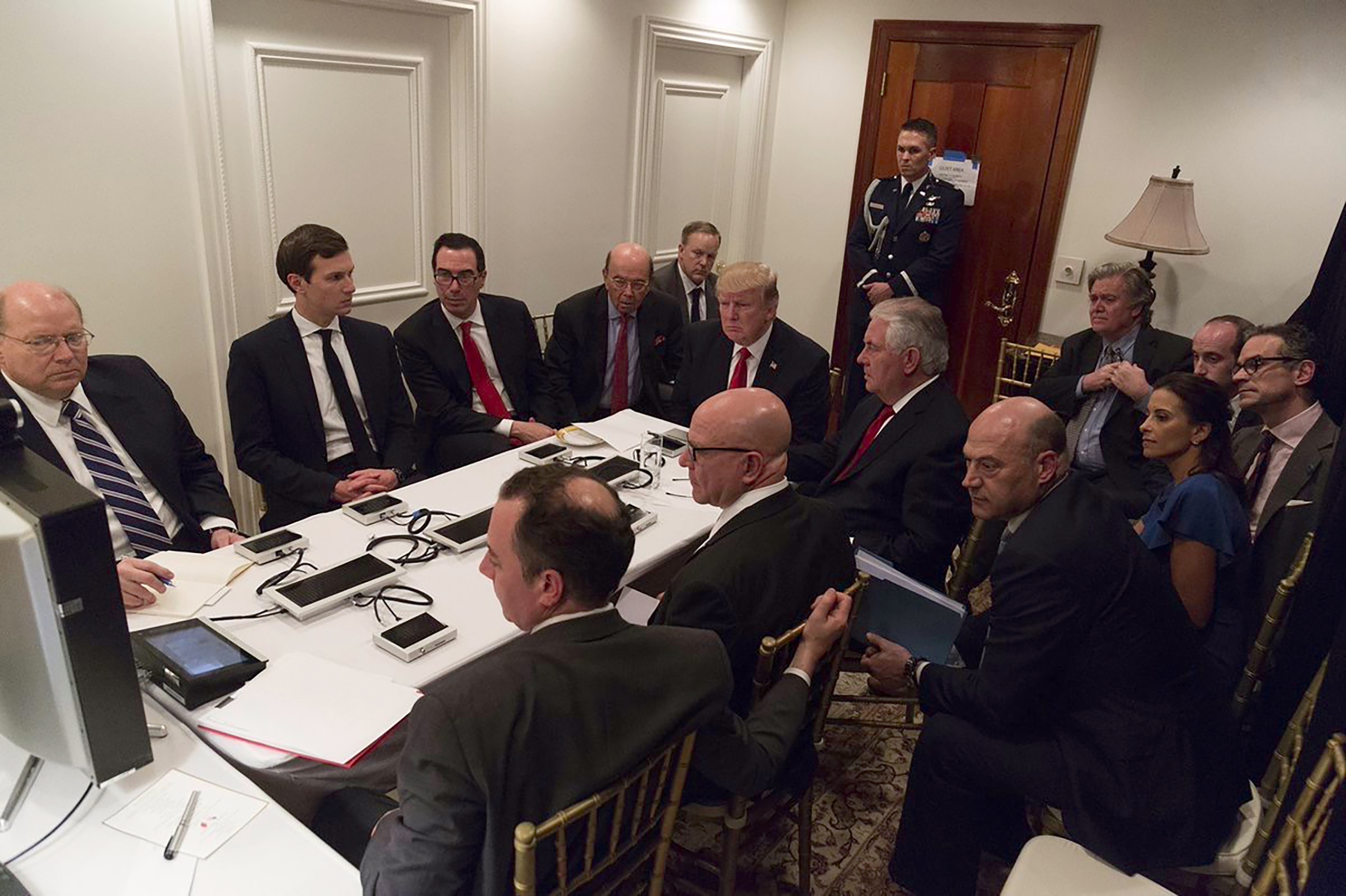 President Donald Trump and Jared Kushner (second, from left) receive a briefing on the Syria military strike from his National Security team, including a video teleconference with Secretary of Defense, Gen. James Mattis, and Chairman of the Joint Chiefs of Staff, Gen. Joseph Dunford, in a secured location at Mar-a-Lago in Palm Beach, Fla on April 6, 2017.