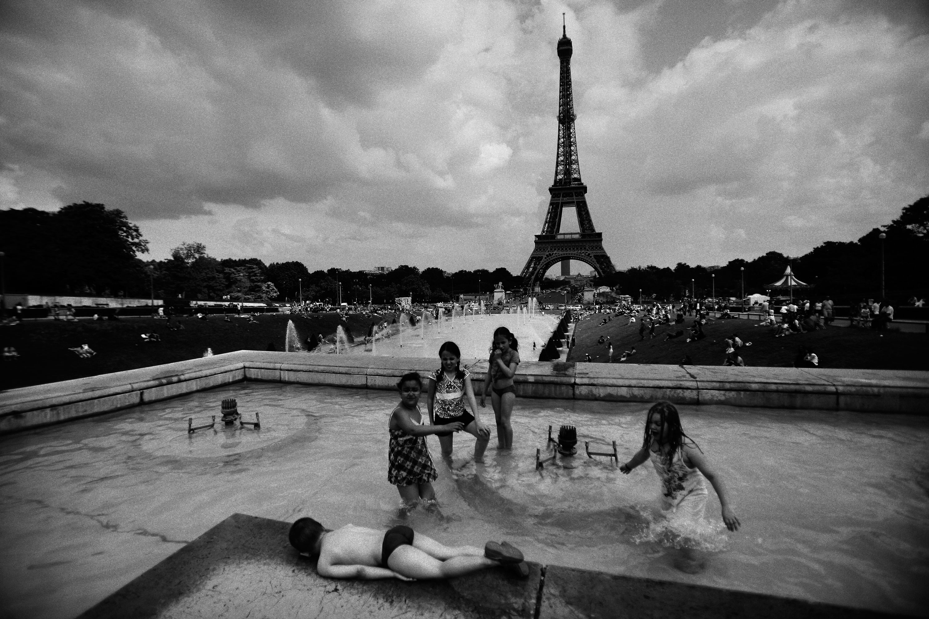 Children play in a fountain at Place du Trocadero in Paris on June 1, 2009.