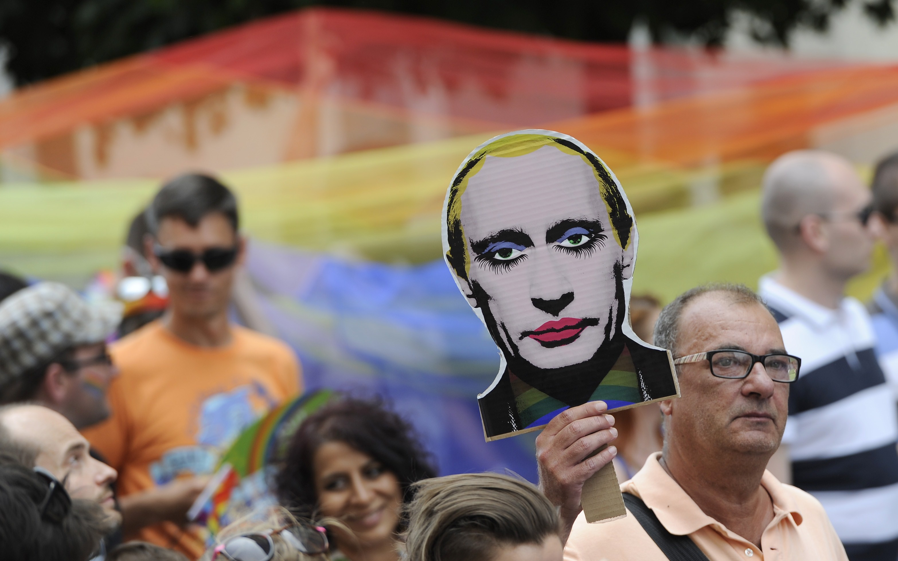 A man holds up a picture of an painted Russian President Vladimir Putin during the LGBT Pride Parade in Bratislava, Slovakia on June 28, 2014.