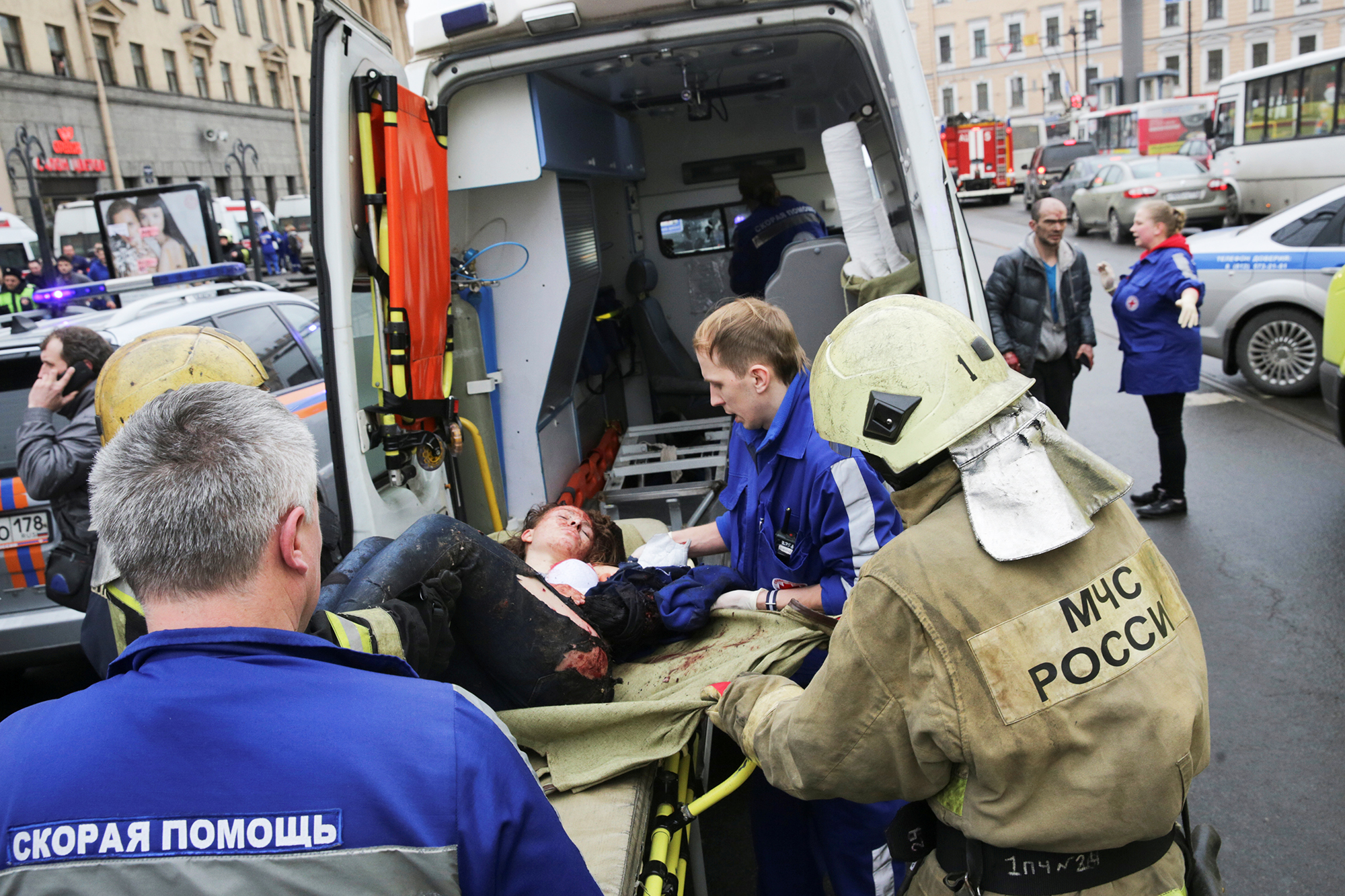 An injured person is helped by emergency services outside Sennaya Ploshchad metro station, following explosions in two train carriages in St. Petersburg, Russia, on April 3, 2017.