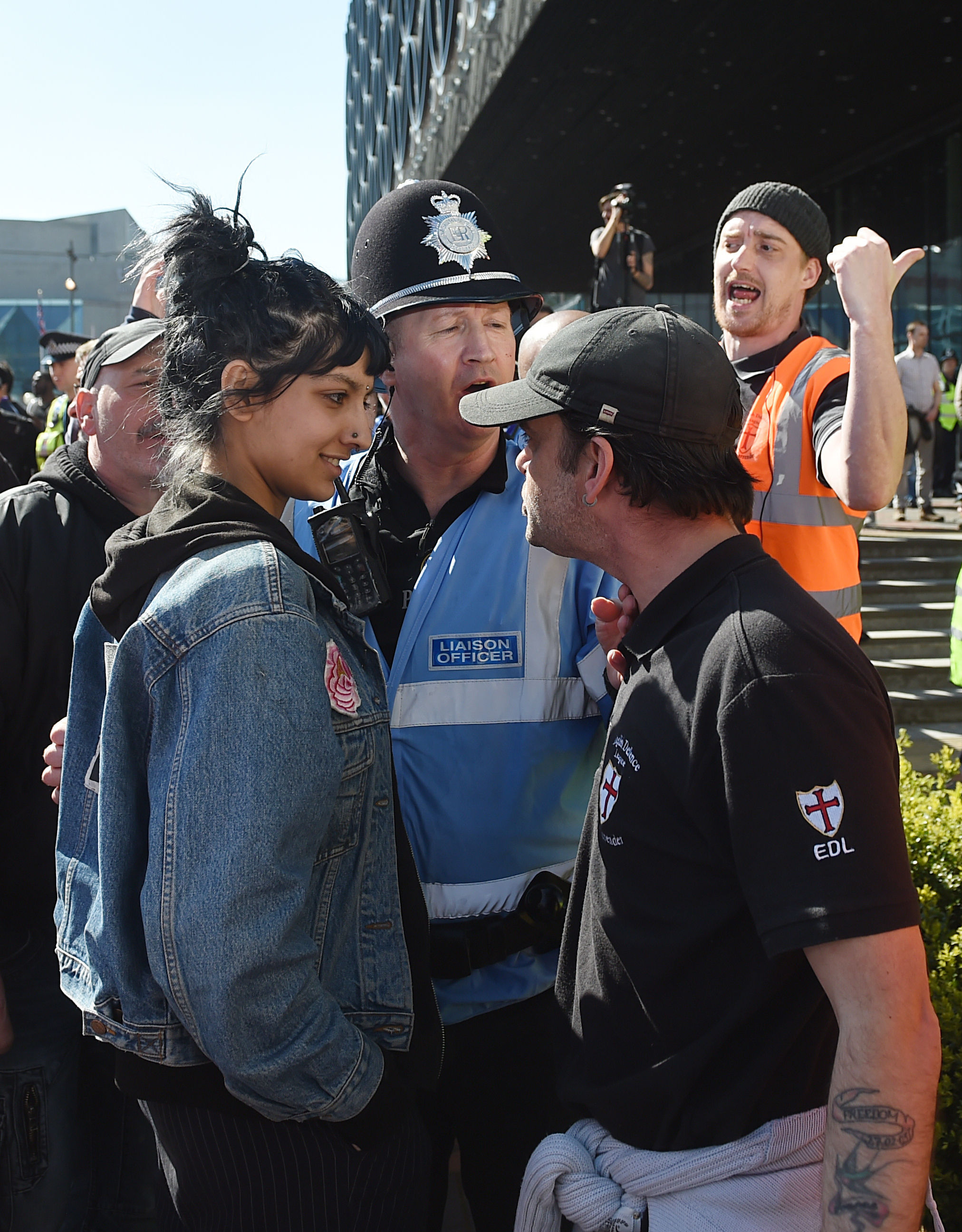 Saffiyah Khan, left, stars down English Defence League protester Ian Crossland during a demonstration in Birmingham, England, on April 10, 2017.