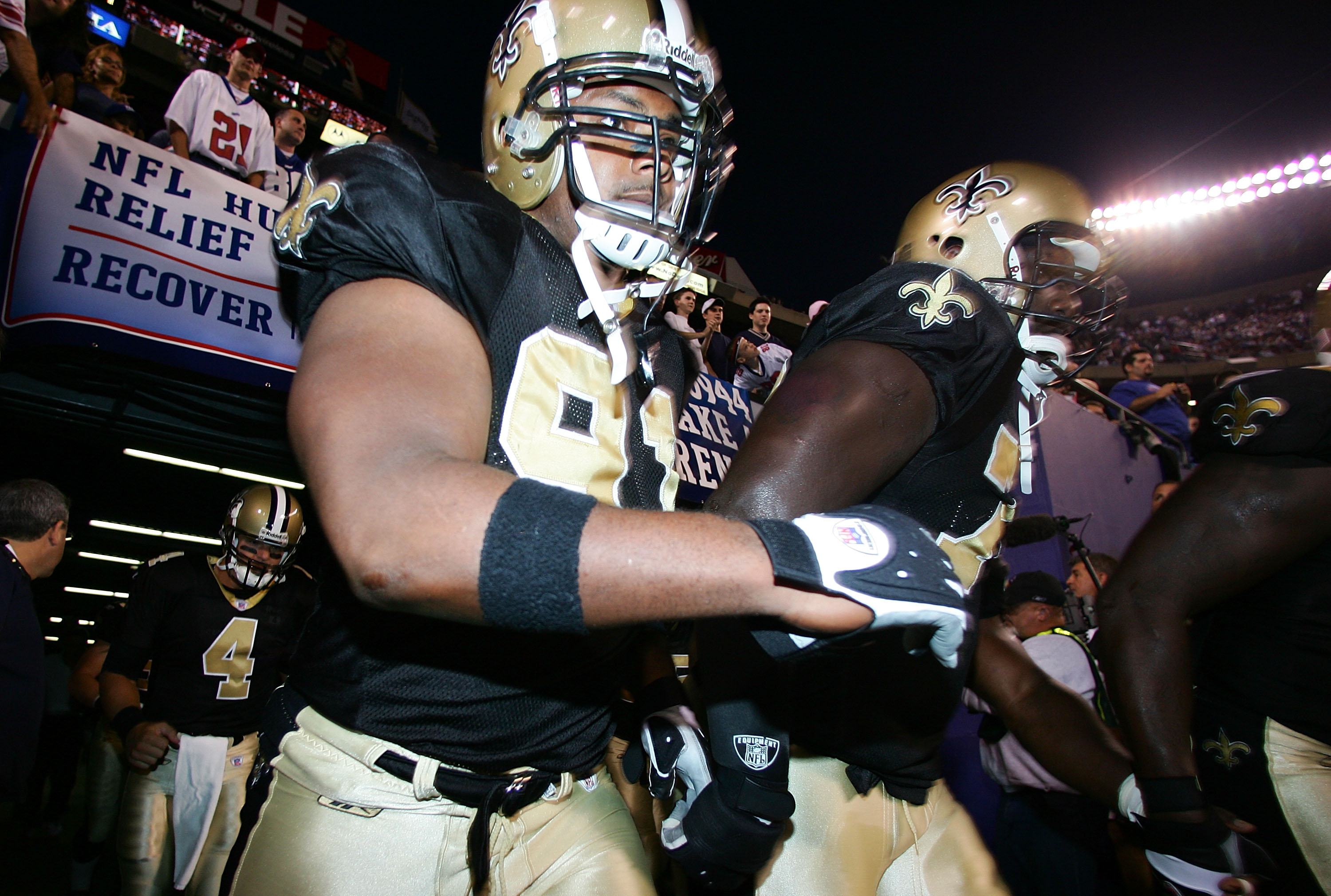 Will Smith and Jammal Brown of the New Orleans Saints take the field before the start of their game against the New York Giants on September 19, 2005 at Giants Stadium in East Rutherford, New Jersey.