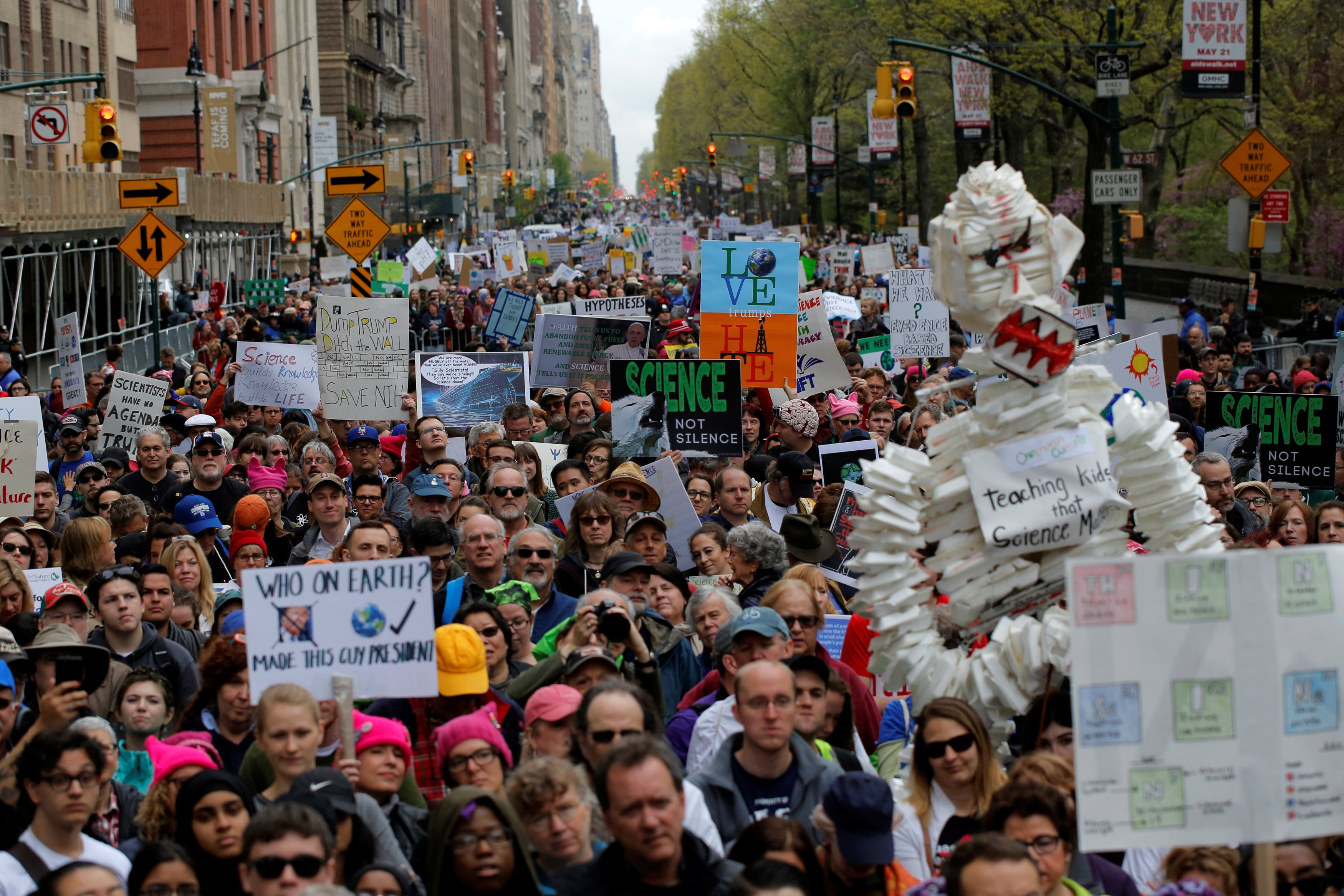 Protesters line Central Park West during the Earth Day 'March For Science NYC' demonstration to coincide with similar marches globally in Manhattan, New York, U.S., April 22, 2017.