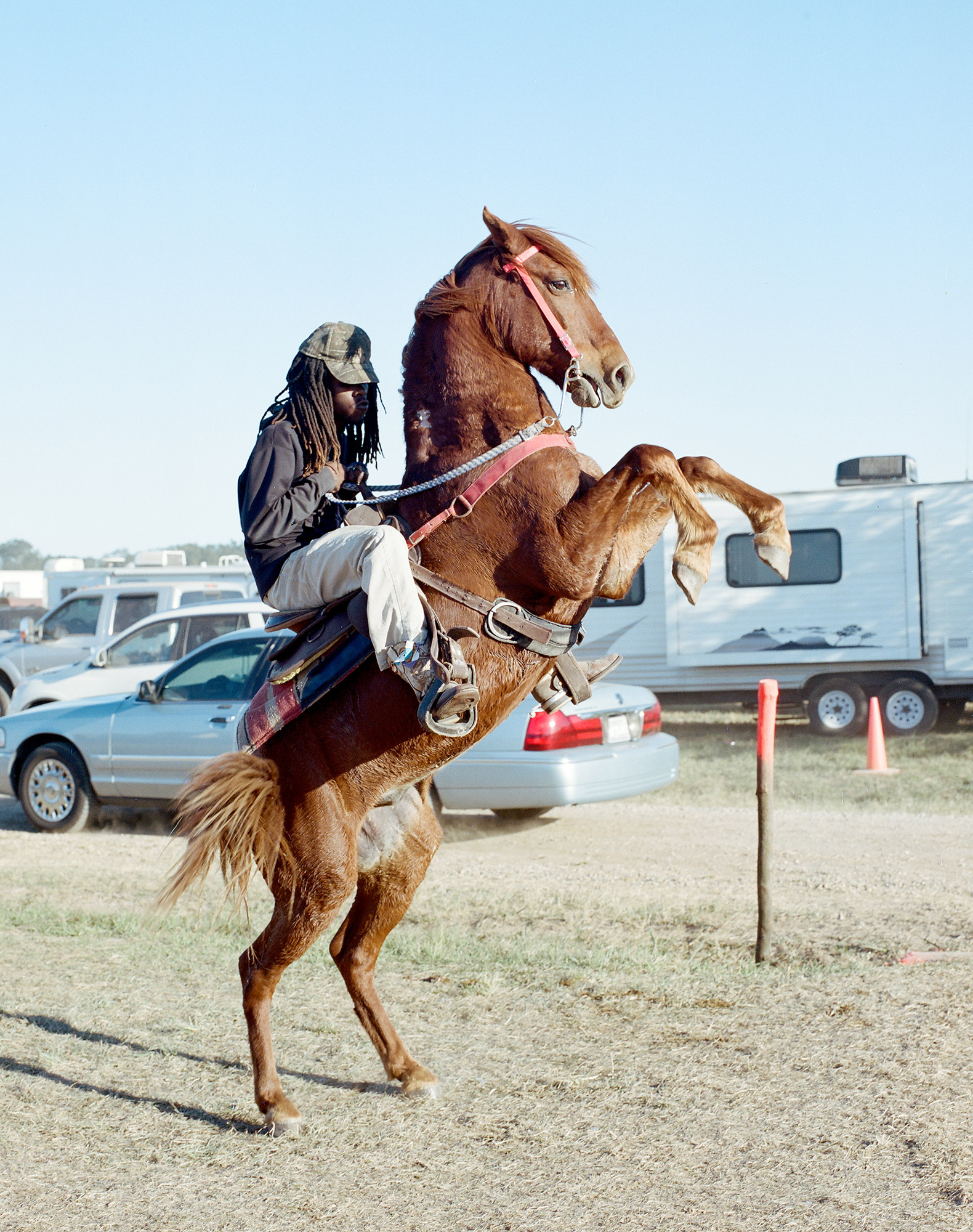A man doing a trick at a trail ride in Southern Louisiana. 2014
