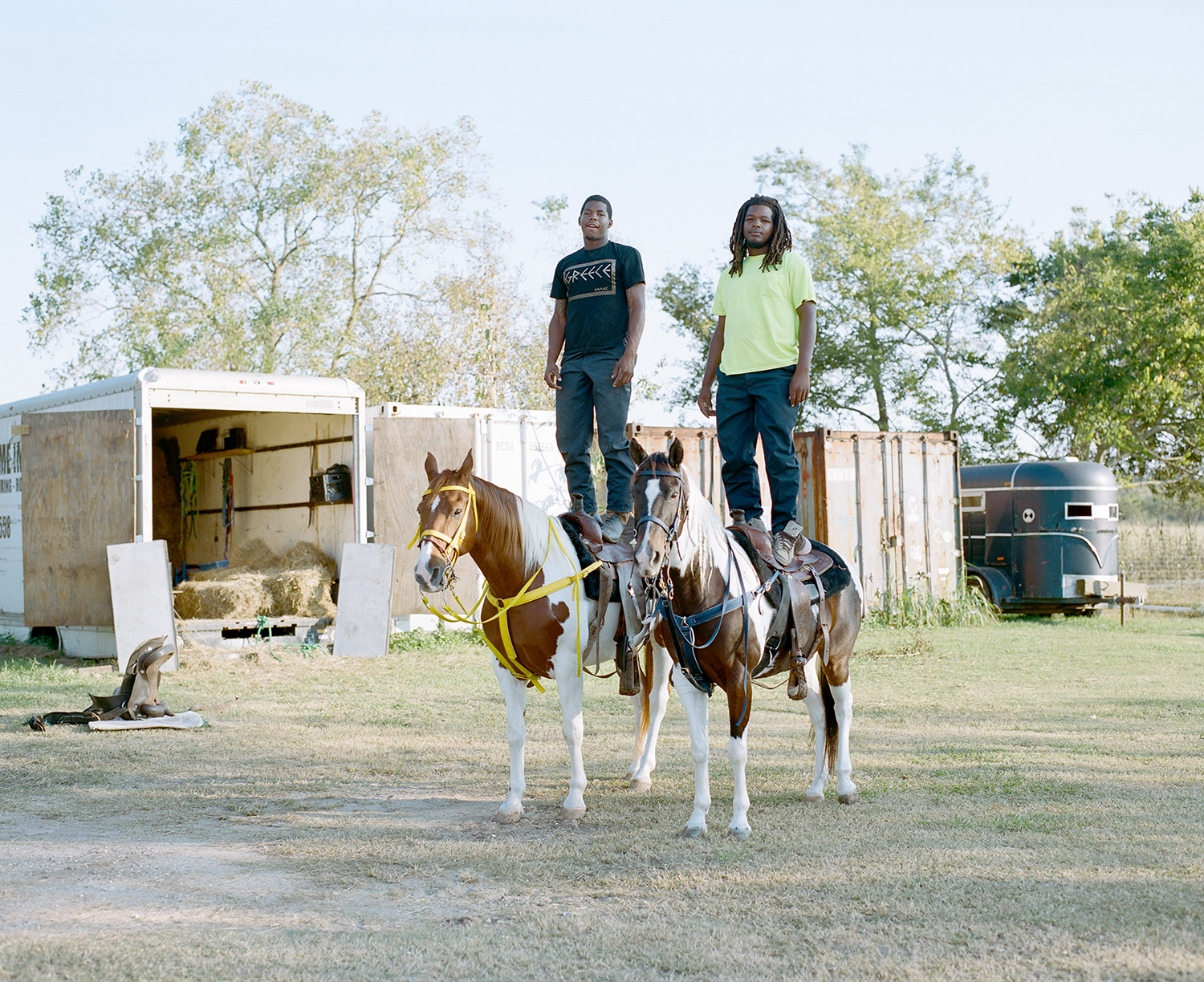 Devence and Dwayne balance on their horses. 2014
