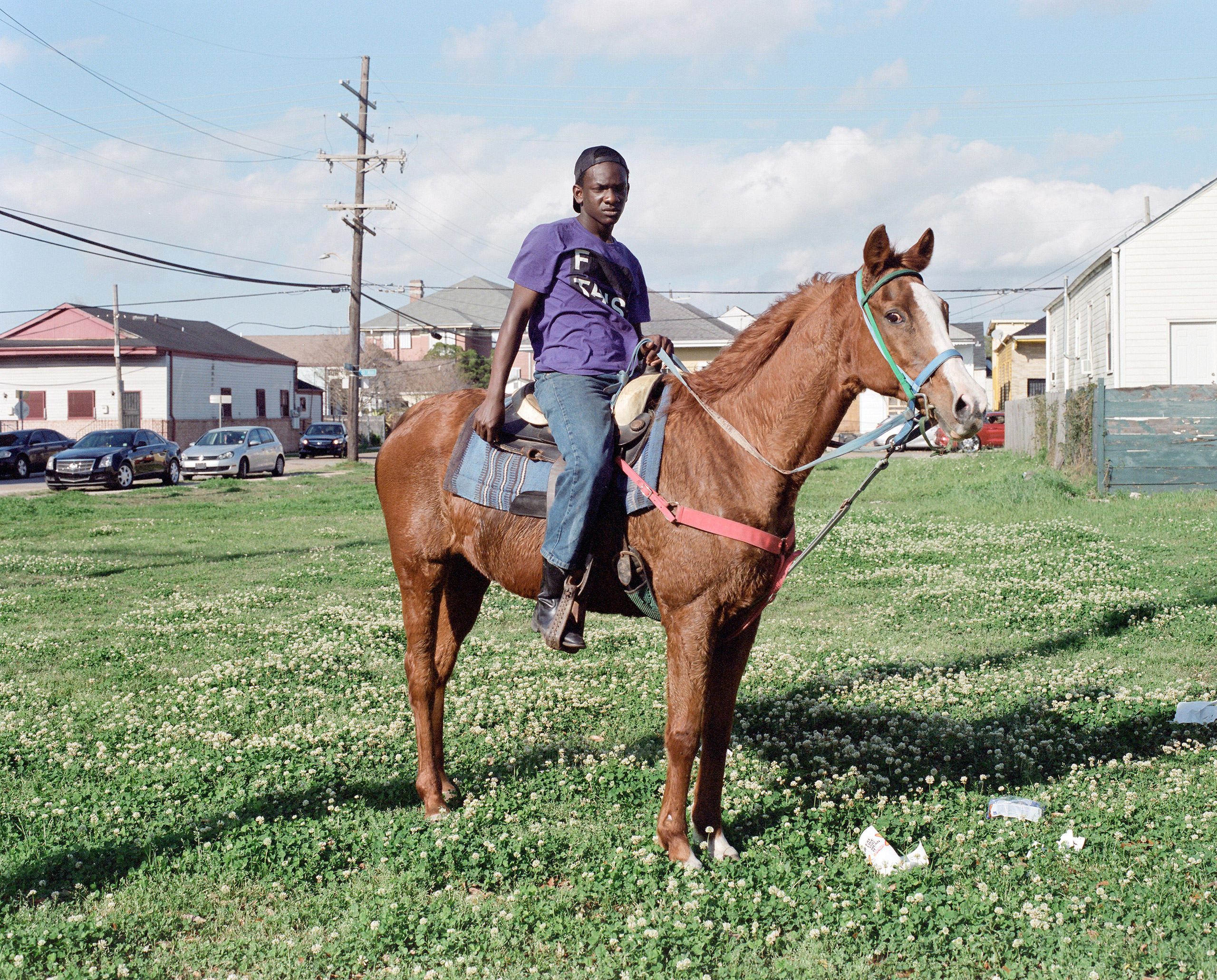 A boy poses on horseback at a Second Line in downtown New Orleans, La. 2016