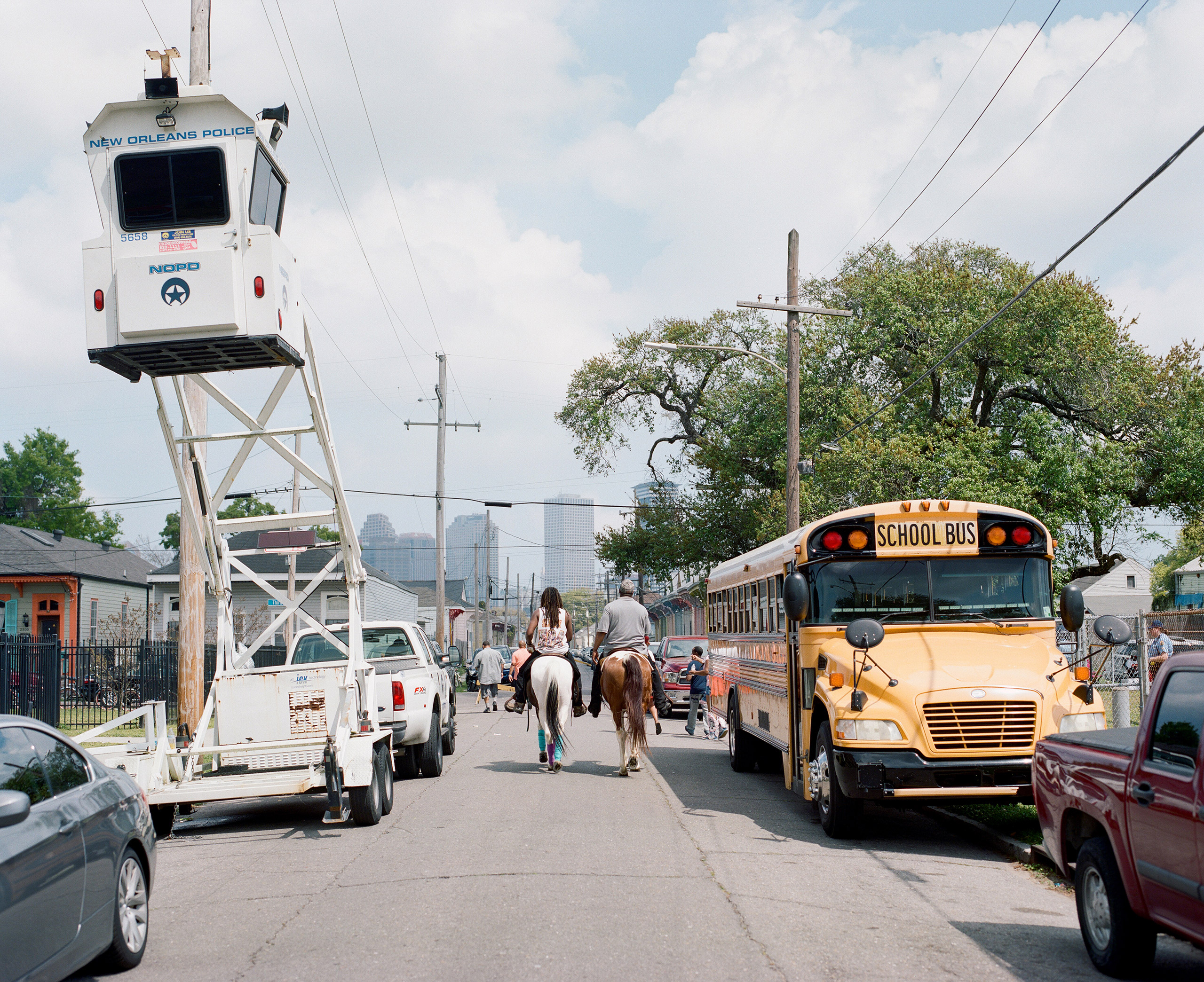 Devence rides through the streets of New Orleans in search of the Uptown Super Sunday Second Line. 2017