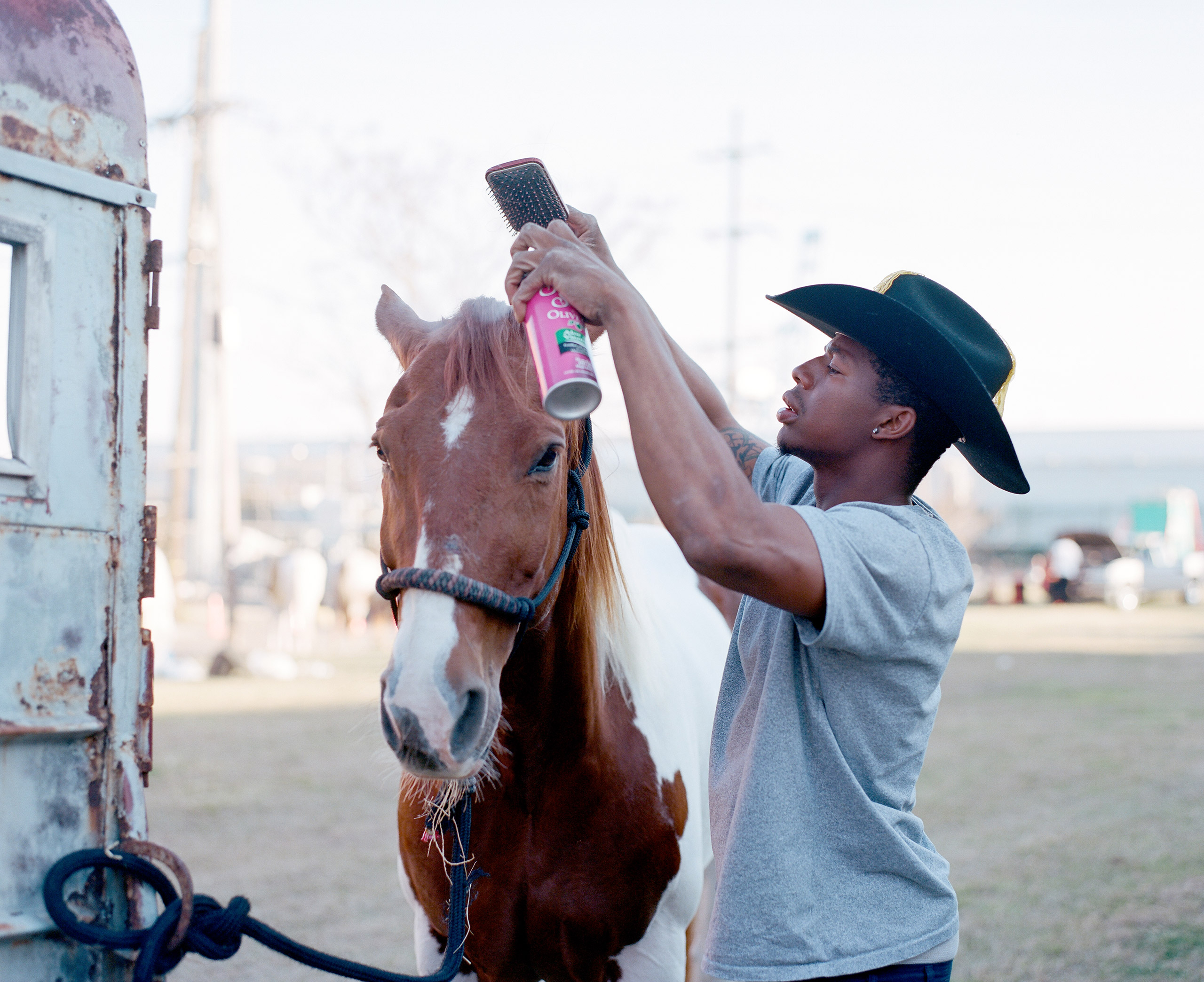Devence grooms his horse before a Mardi Gras parade. 2015