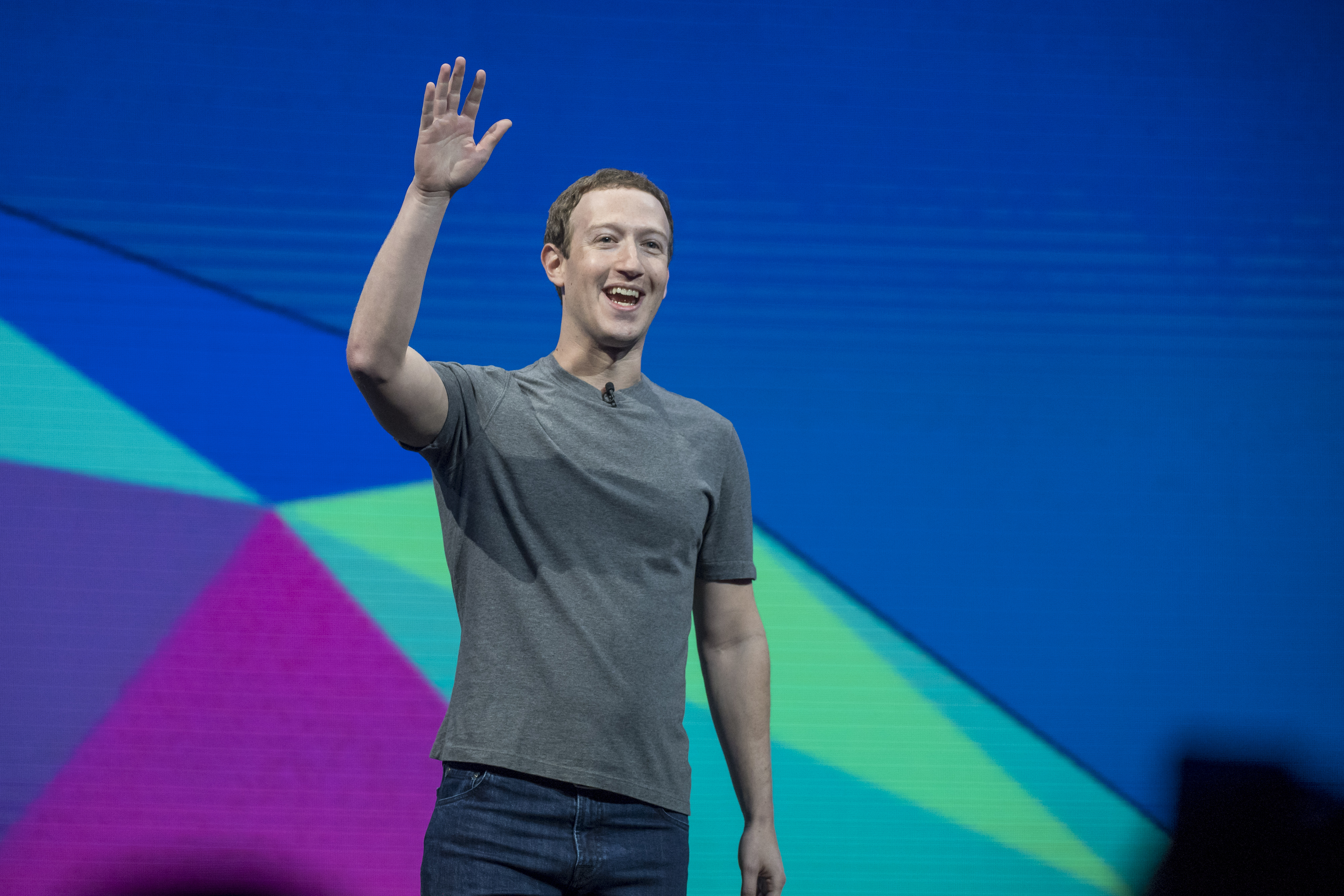 Mark Zuckerberg, chief executive officer and founder of Facebook Inc., waves to attendees during the F8 Developers Conference in San Jose, California, U.S., on Tuesday, April 18, 2017.