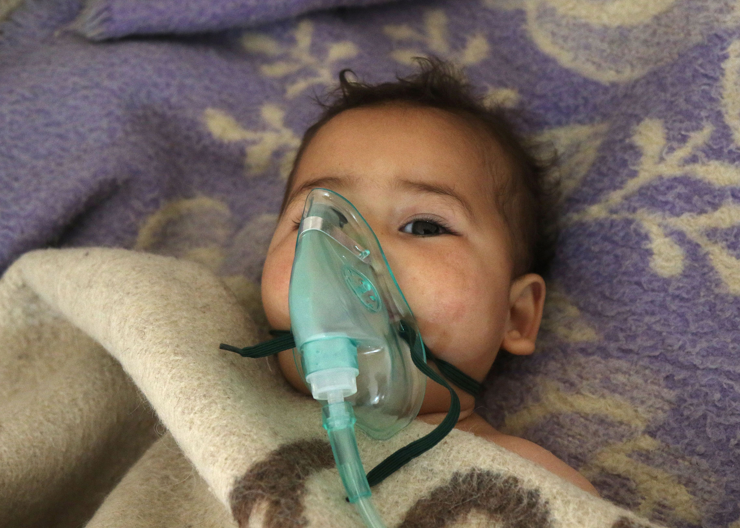 A Syrian child receives treatment after a suspected gas attack at a small hospital in Maaret al-Noman, a rebel-held town in Idlib province, on April 4, 2017.