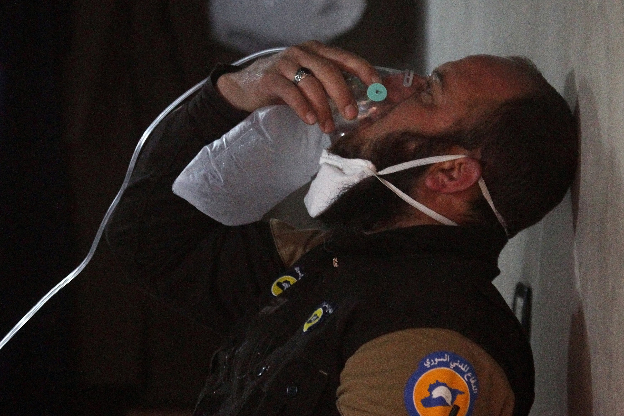A civil defence member breathes through an oxygen mask after what rescue workers described as a suspected gas attack in the town of Khan Sheikhoun, in rebel-held Idlib, Syria, on April 4, 2017.
