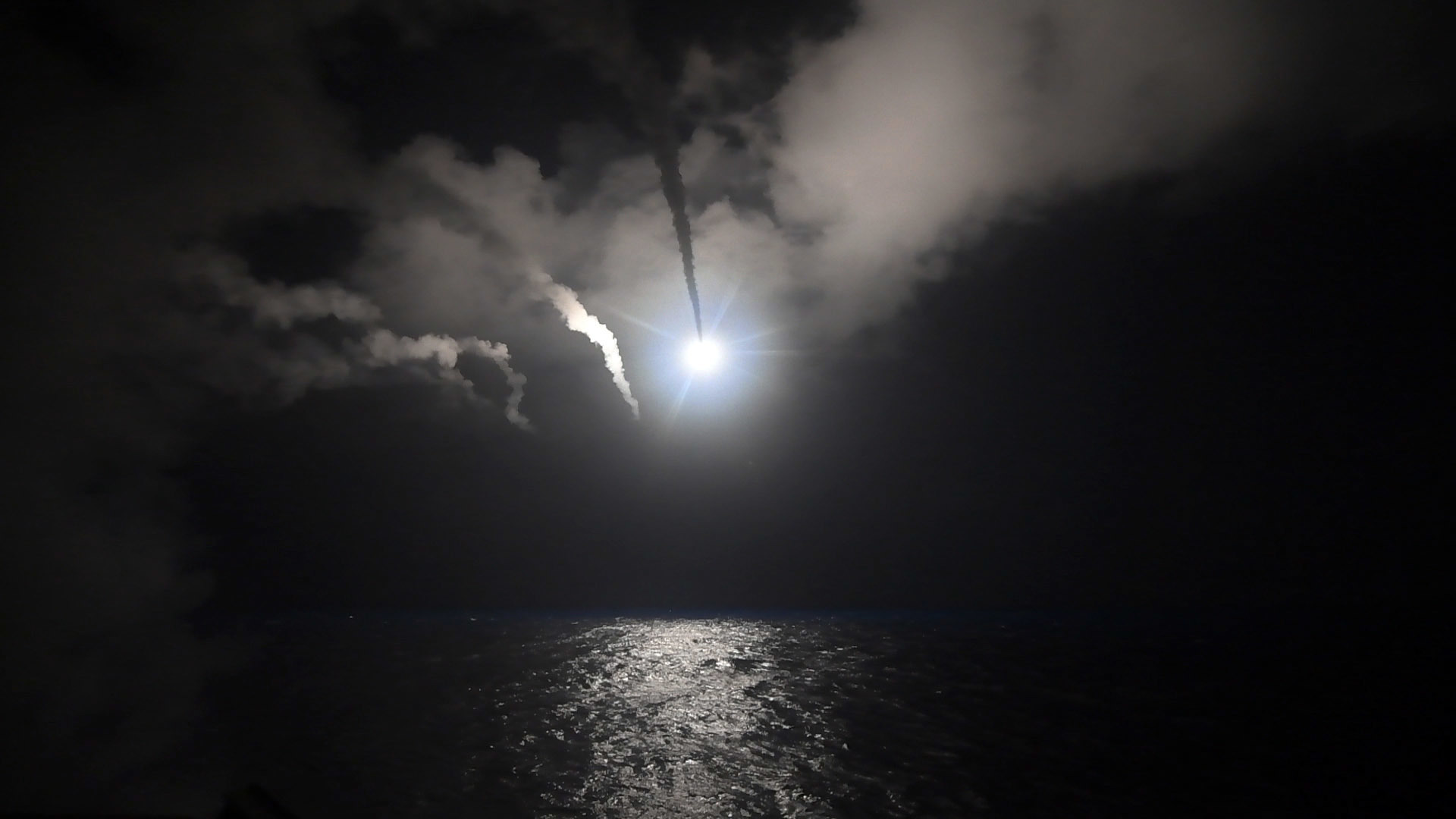 In this image provided by the U.S. Navy, the guided-missile destroyer USS Porter (DDG 78) launches a tomahawk land attack missile in the Mediterranean Sea, April 7, 2017.