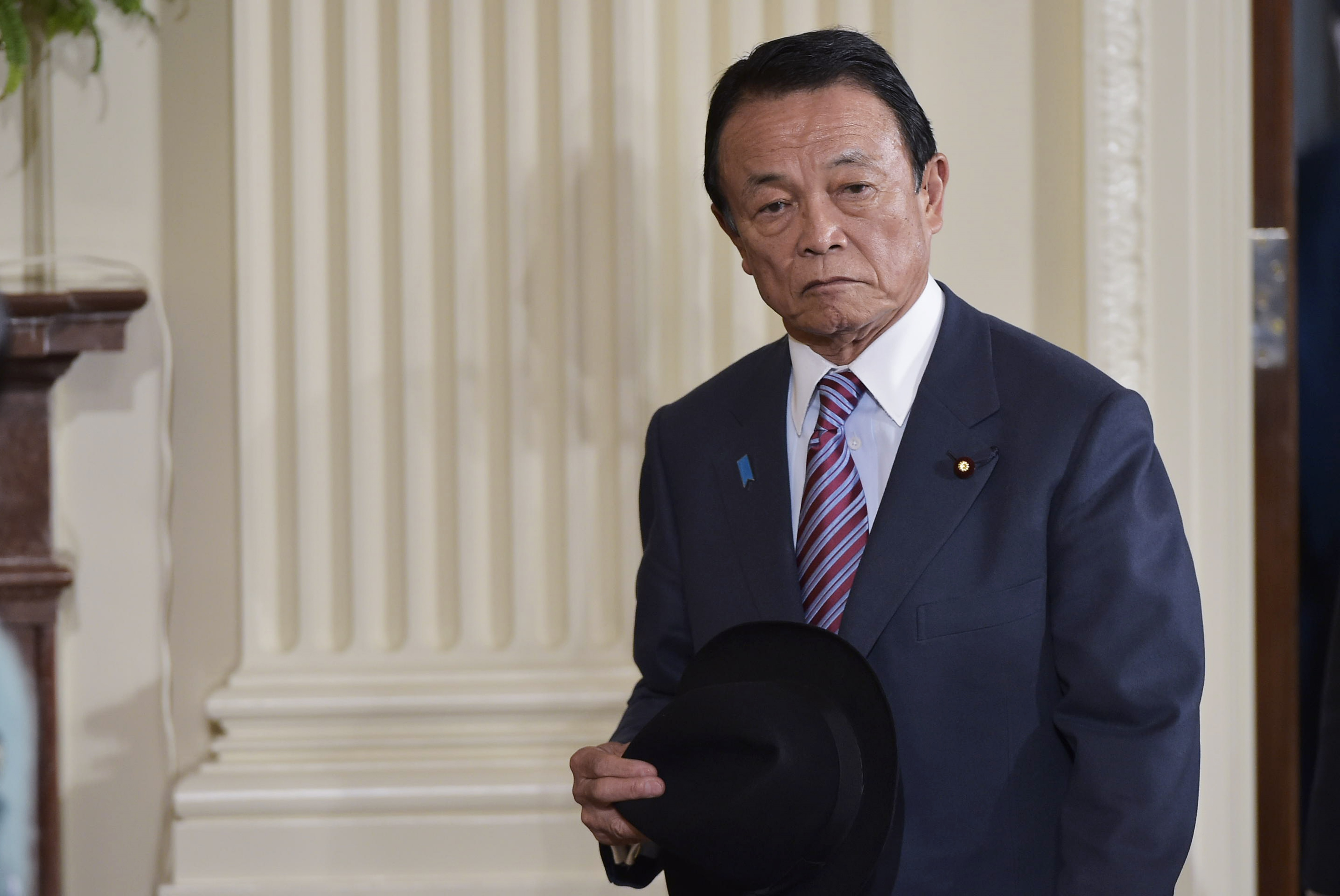 Japan's Deputy Prime Minister and Minister of Finance Taro Aso arrives for a joint press conference by US President Donald Trump and Japanese Prime Minister Shinzo Abe on February 10, 2017, at the White House in Washington, DC.