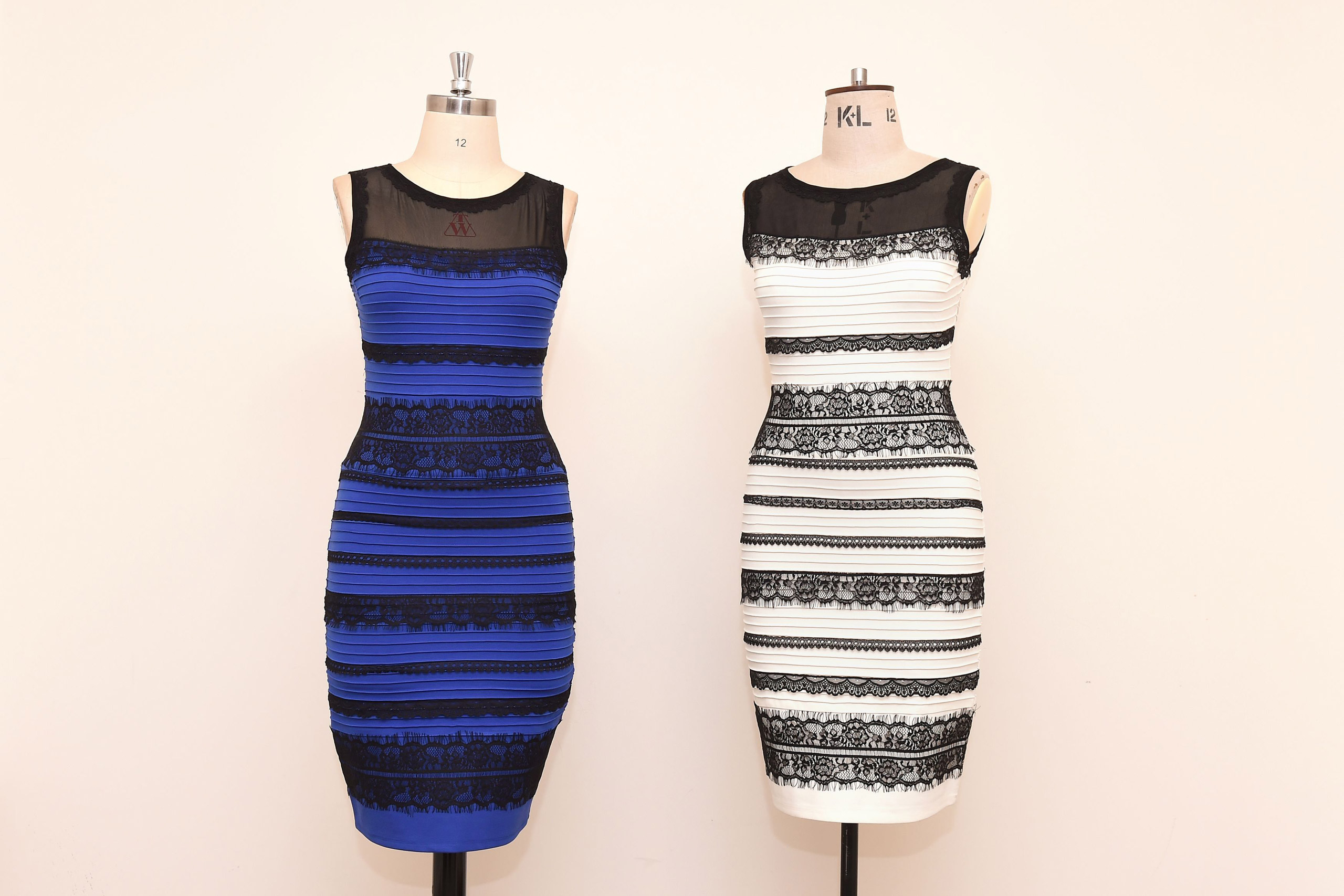 The two-tone dress, left, alongside an ivory and black version, made by Roman Originals, that has sparked a global debate on Twitter over what colour it is on display in Birmingham, England on February 27, 2015.