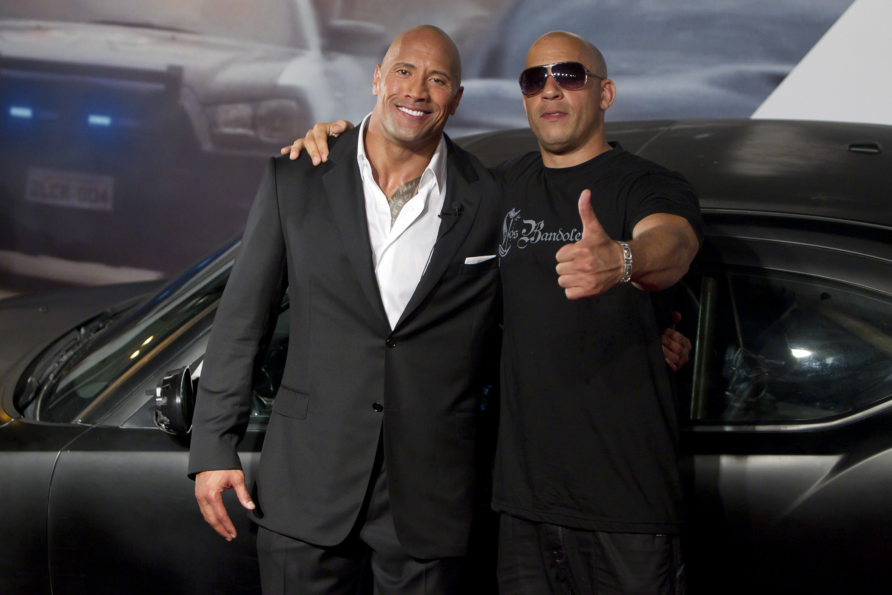Dwayne Johnson (The Rock) and Vin Diesel (R) pose for photographers during the premiere of the movie  Fast and Furious 5  at Cinepolis Lagoon on April 15, 2011 in Rio de Janeiro, Brazil.