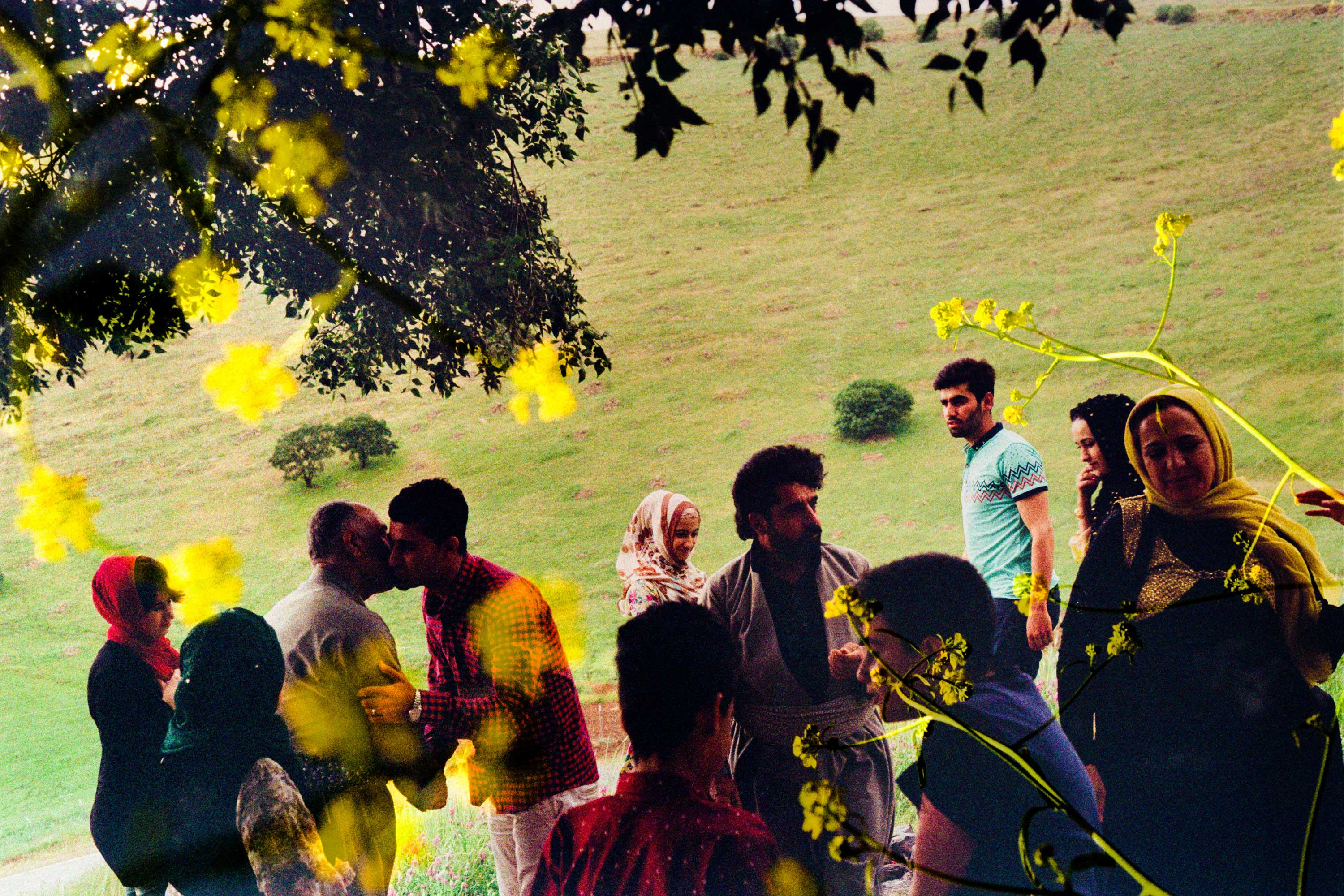 A family enjoys a reunion gathering in the hilly outskirts of Ahmad Awa, near the border of Iran, in Iraqi Kurdistan, on May 7, 2016. Many family members who live outside Iraqi Kurdistan will travel from outside the country to visit friends and relatives during the springtime to go on picnics. The family pictured here had relatives living in Australia who came to visit them.