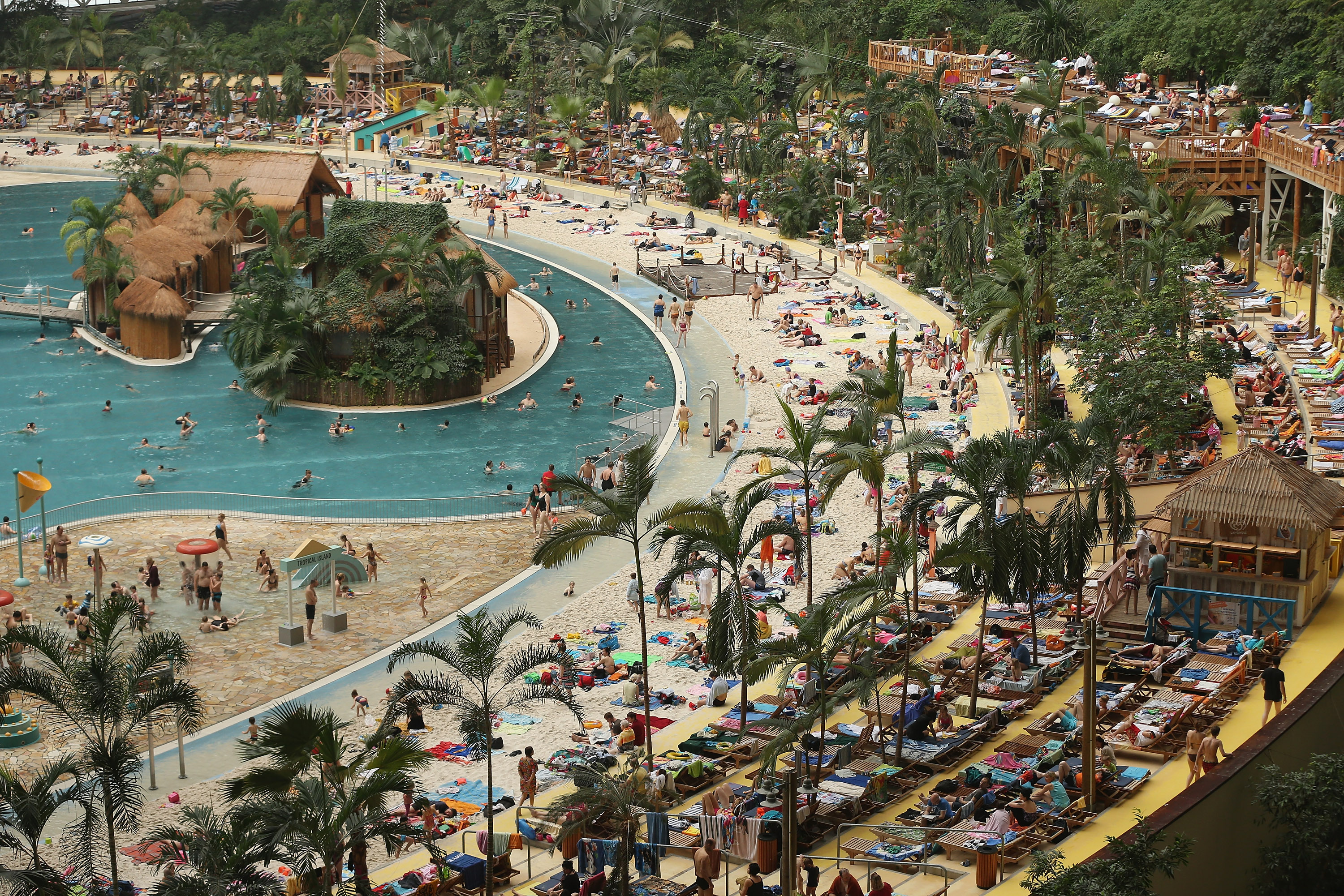 Visitors lounge at the  South Sea  beach at the Tropical Islands indoor resort on Feb. 15, 2013 in Krausnick, Germany.