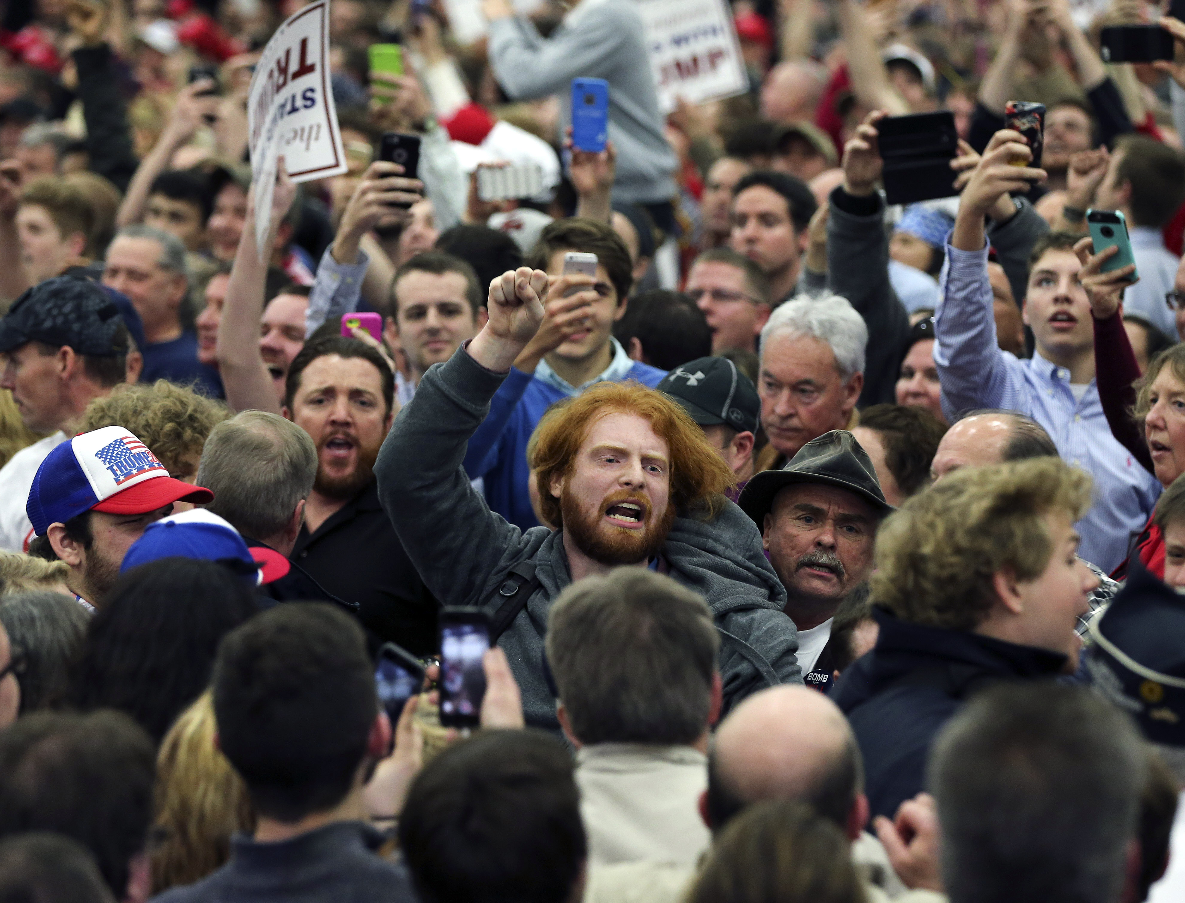 A protester is escorted out of a rally on March 1, 2016 for Republican Presidential candidate Donald Trump in Louisville, Ky.