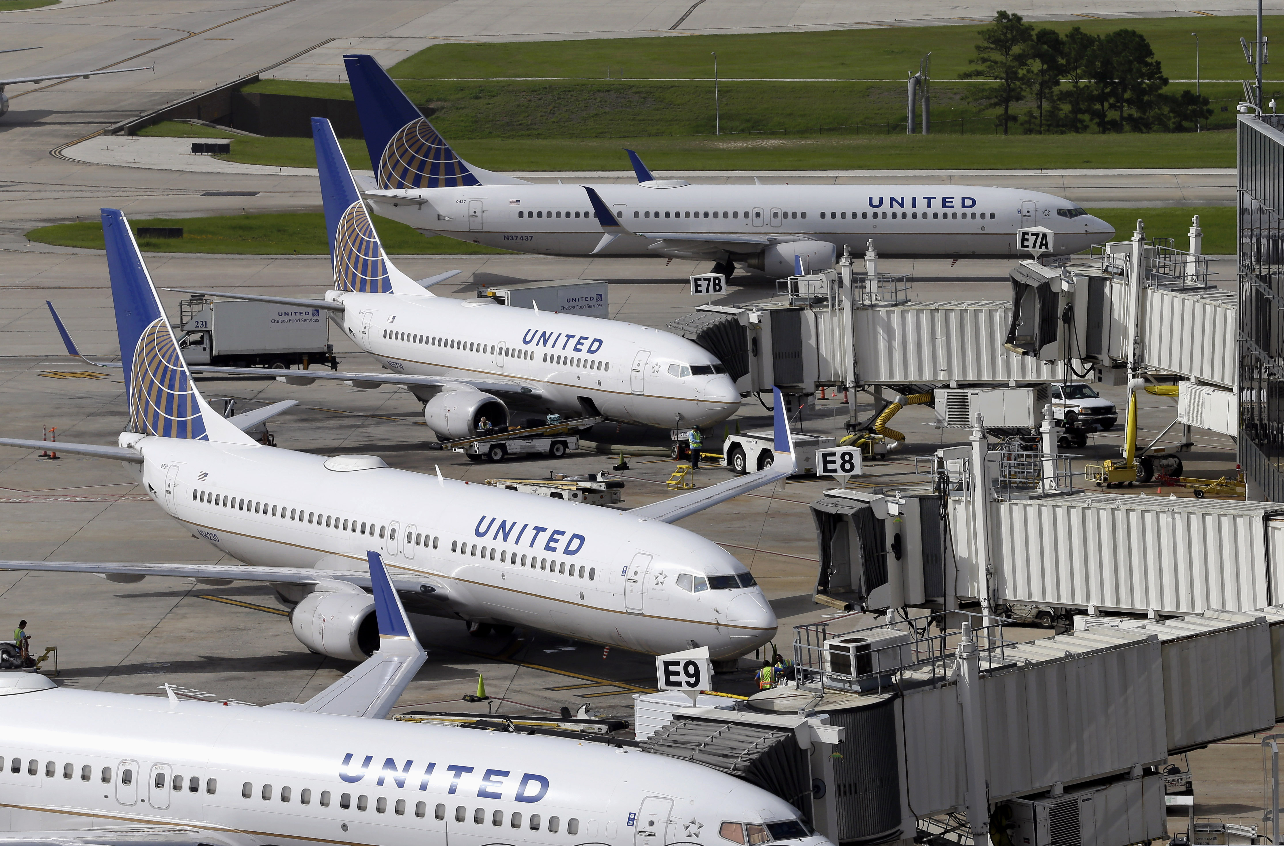 In this July 8, 2015, file photo, United Airlines planes are parked at their at George Bush Intercontinental Airport in Houston.