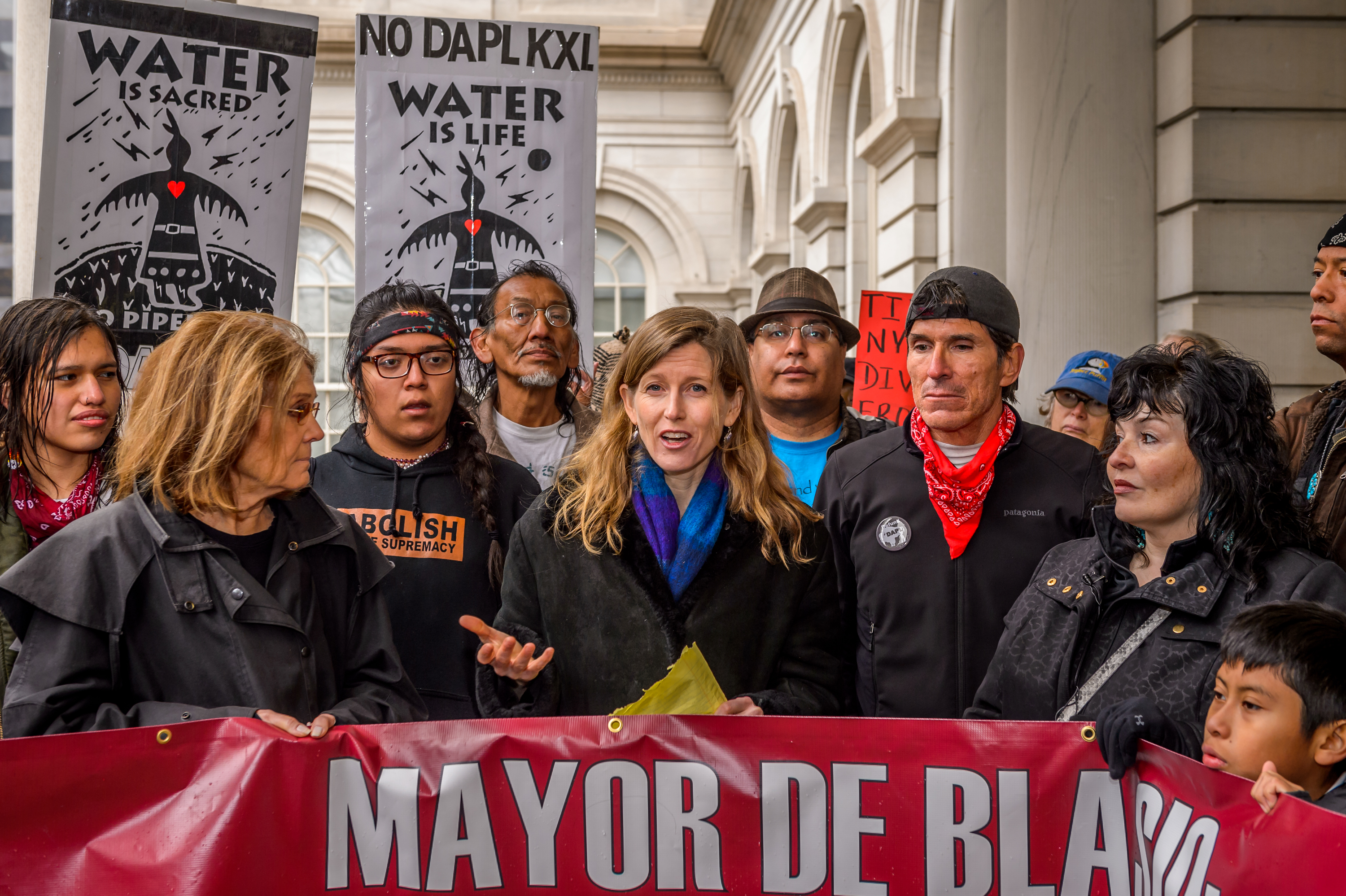 Center for Earth Ethics Director Karenna Gore protests with the #NoDAPL encampment at Wells Fargo, calling on Mayor Bill de Blasio, as well as the New York City Comptroller Stringer to end the city's business with and investments into Wall Street banks attacking Native Nations. The protest march began at Wells Fargo at 463 Broadway and reached City Hall for a rally at the City Hall steps with women's rights leader and activist icon Gloria Steinem.