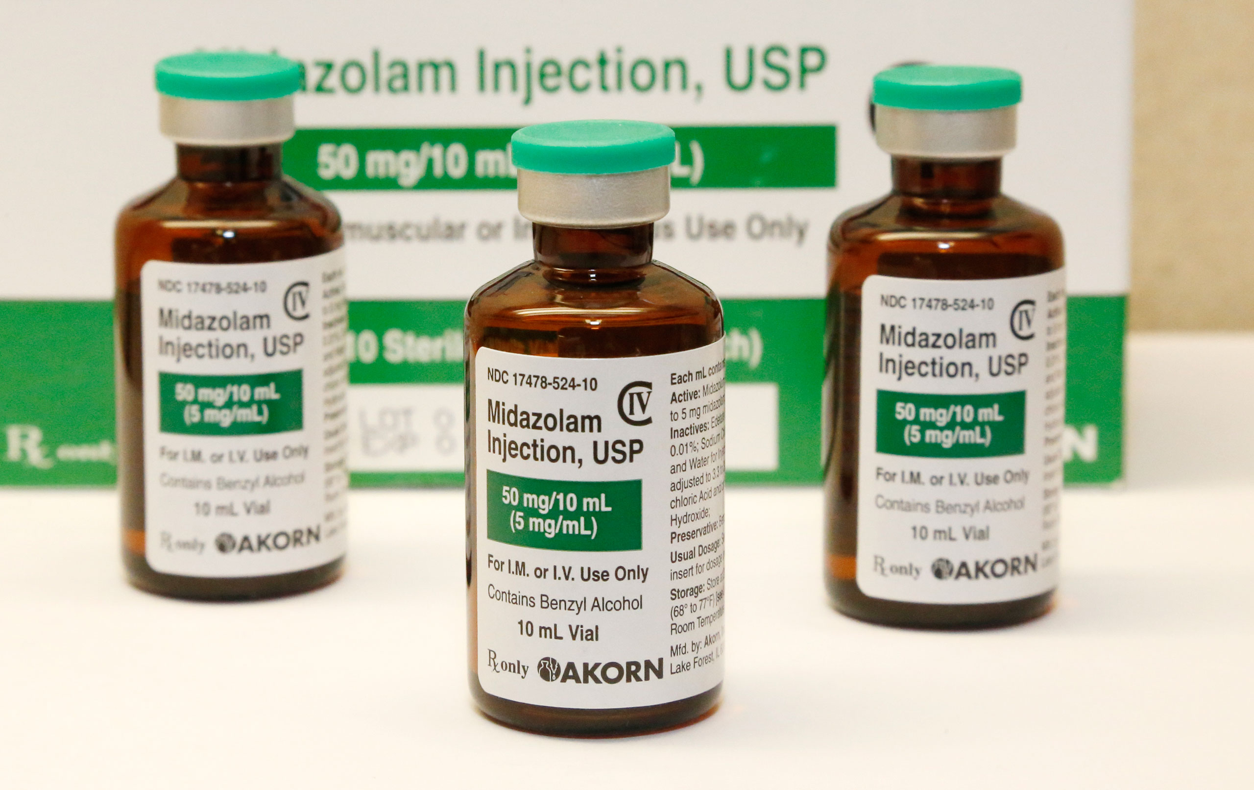 This July 25, 2014 file photo shows bottles of the sedative midazolam at a hospital pharmacy in Oklahoma City. The Arkansas Supreme Court ruled Thursday, June 23, 2016, that the state can execute eight death row inmates using its three-drug protocol, upholding a state law that keeps information about lethal injection drugs confidential.