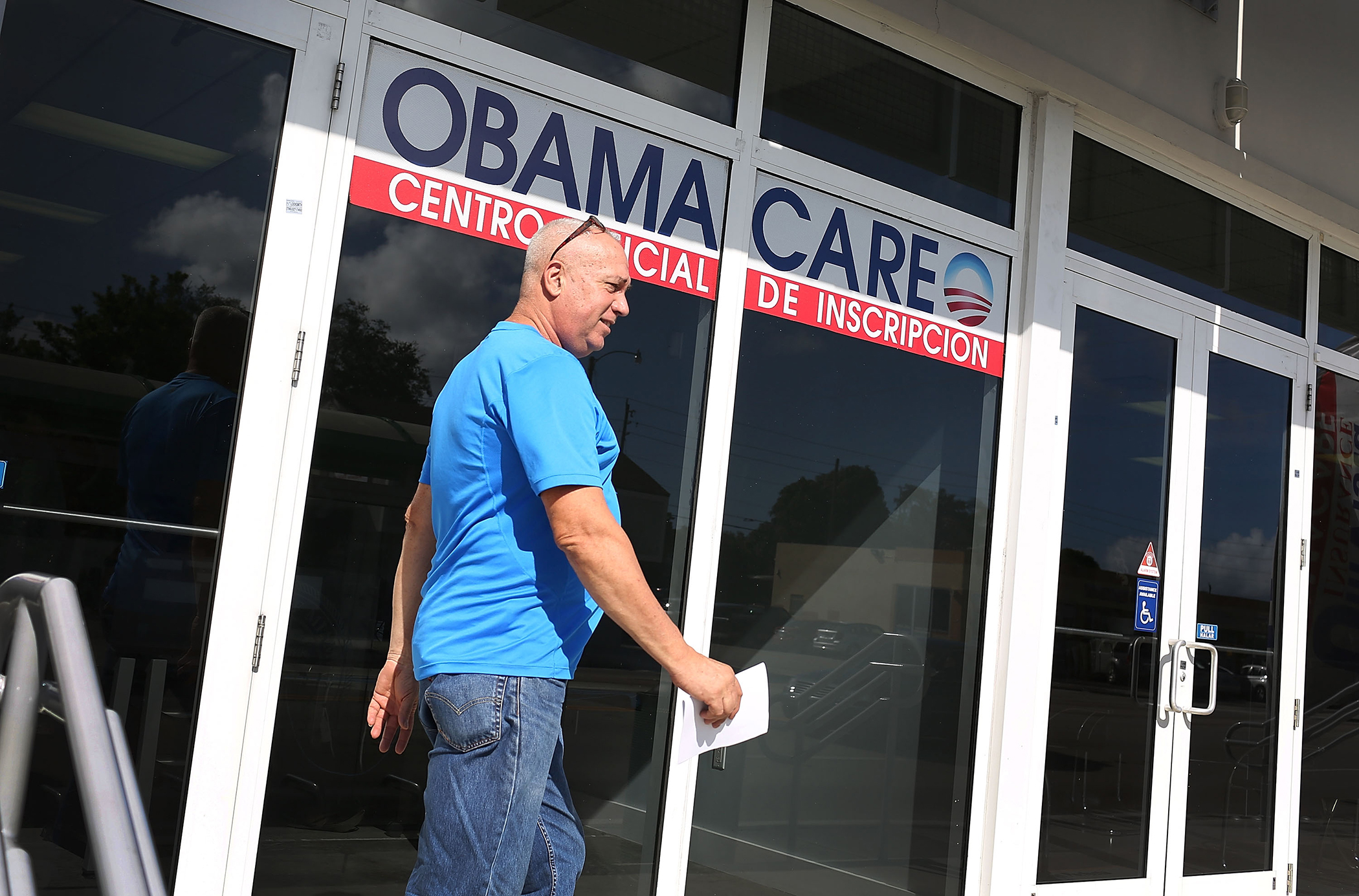 Alberto Abin walks out of the UniVista Insurance company office after shopping for a health plan under the Affordable Care Act, also known as Obamacare, on December 15, 2015 in Miami, Florida.
