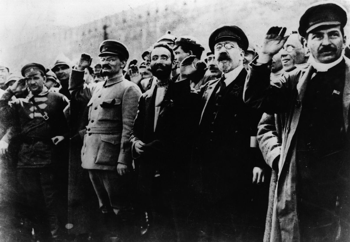Communist leaders including Joseph Stalin (1879 - 1953) and Leon Trotsky (1879 - 1940) seen saluting in the street in 1917.
