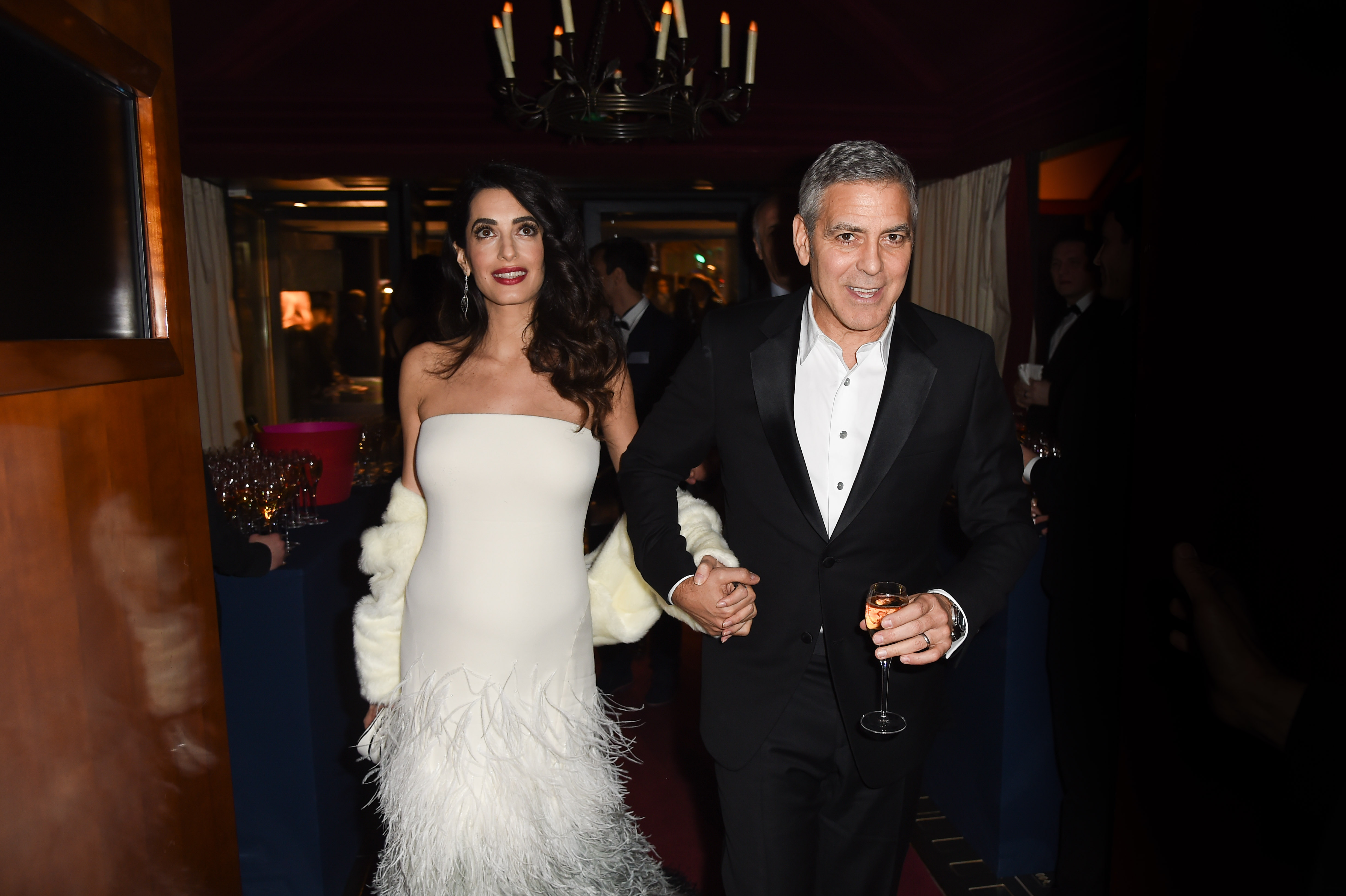 George Clooney and Amal Clooney attend the Cesar Dinner at Le Fouquet's on February 24, 2017 in Paris, France.