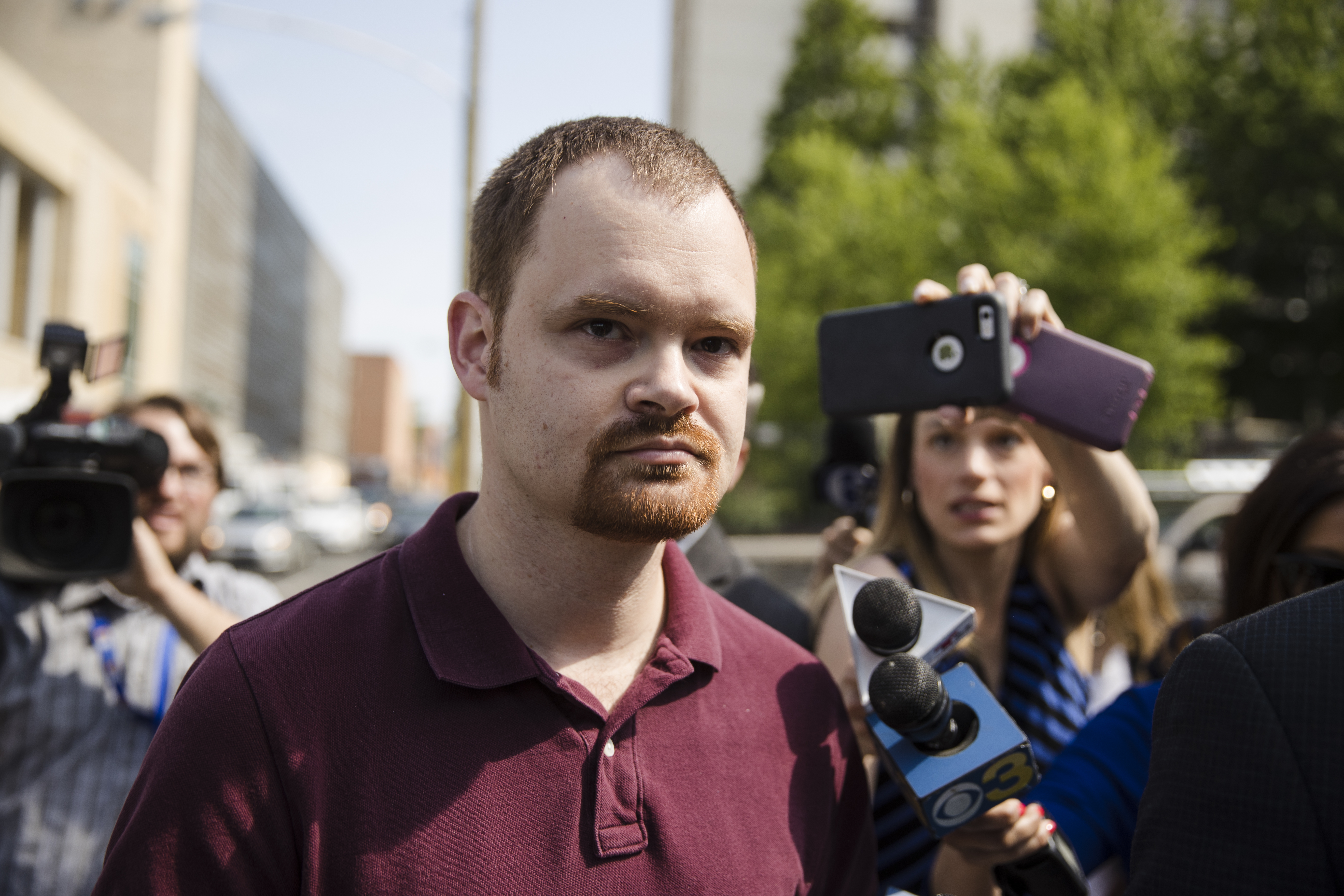 Brandon Bostian, the Amtrak engineer involved in a fatal train crash two years ago, walks to a police station in Philadelphia on Thursday, May 18, 2017, to turn himself in to answer charges including causing a catastrophe and involuntary manslaughter.