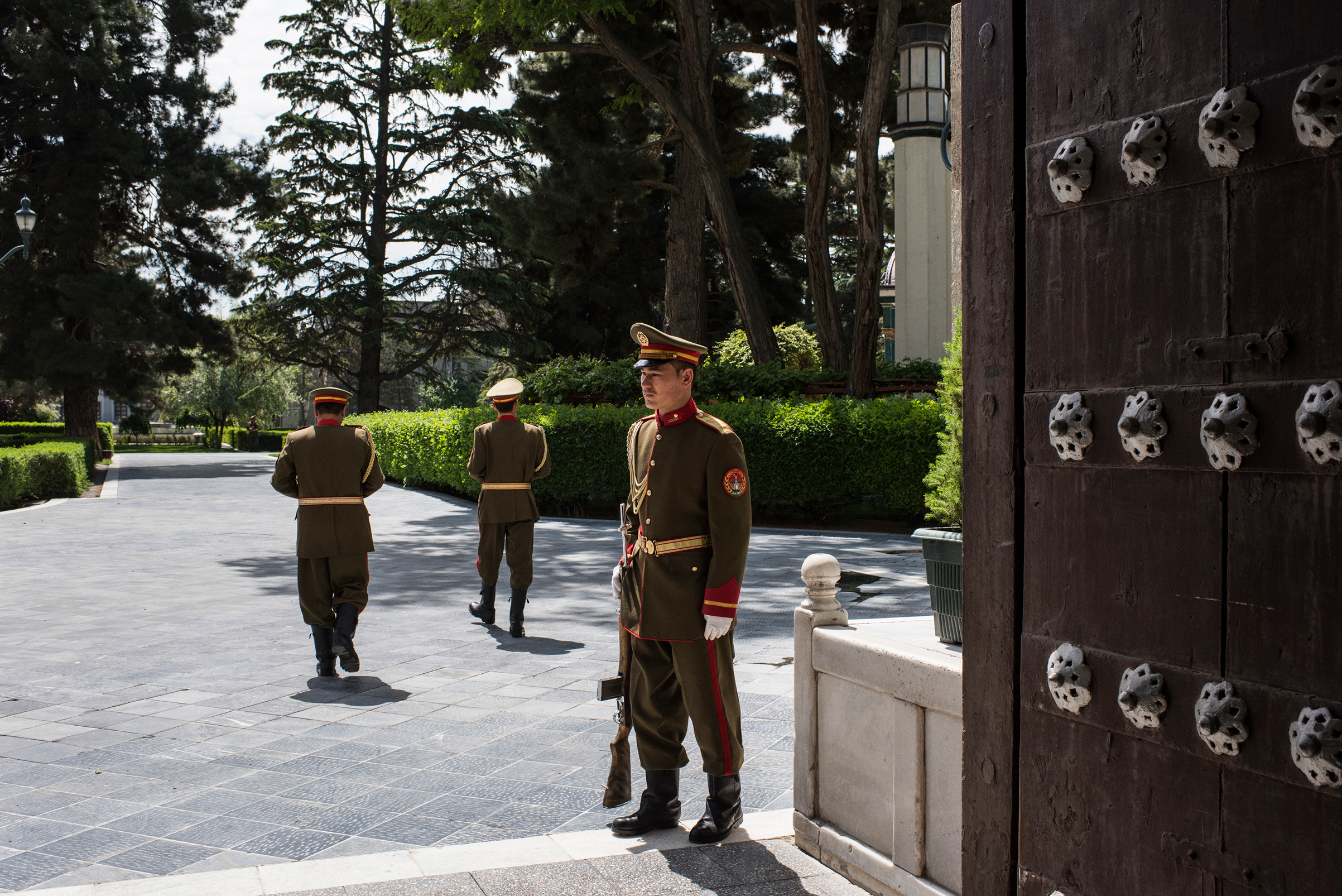 A presidential guard stands watch inside the palace compound in Kabul on May 11.