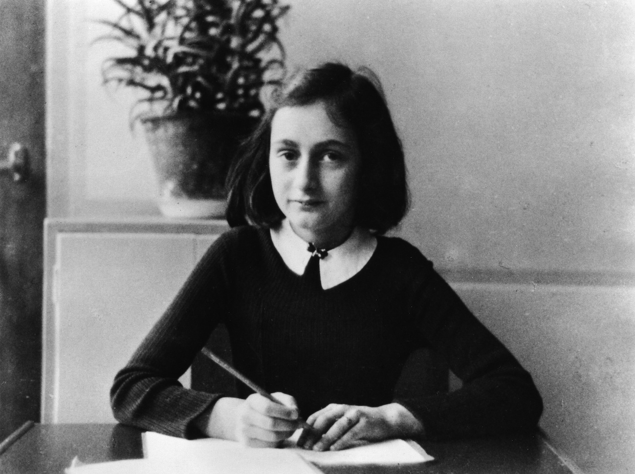 Anne Frank, as a 12-year old doing her homework in 1941