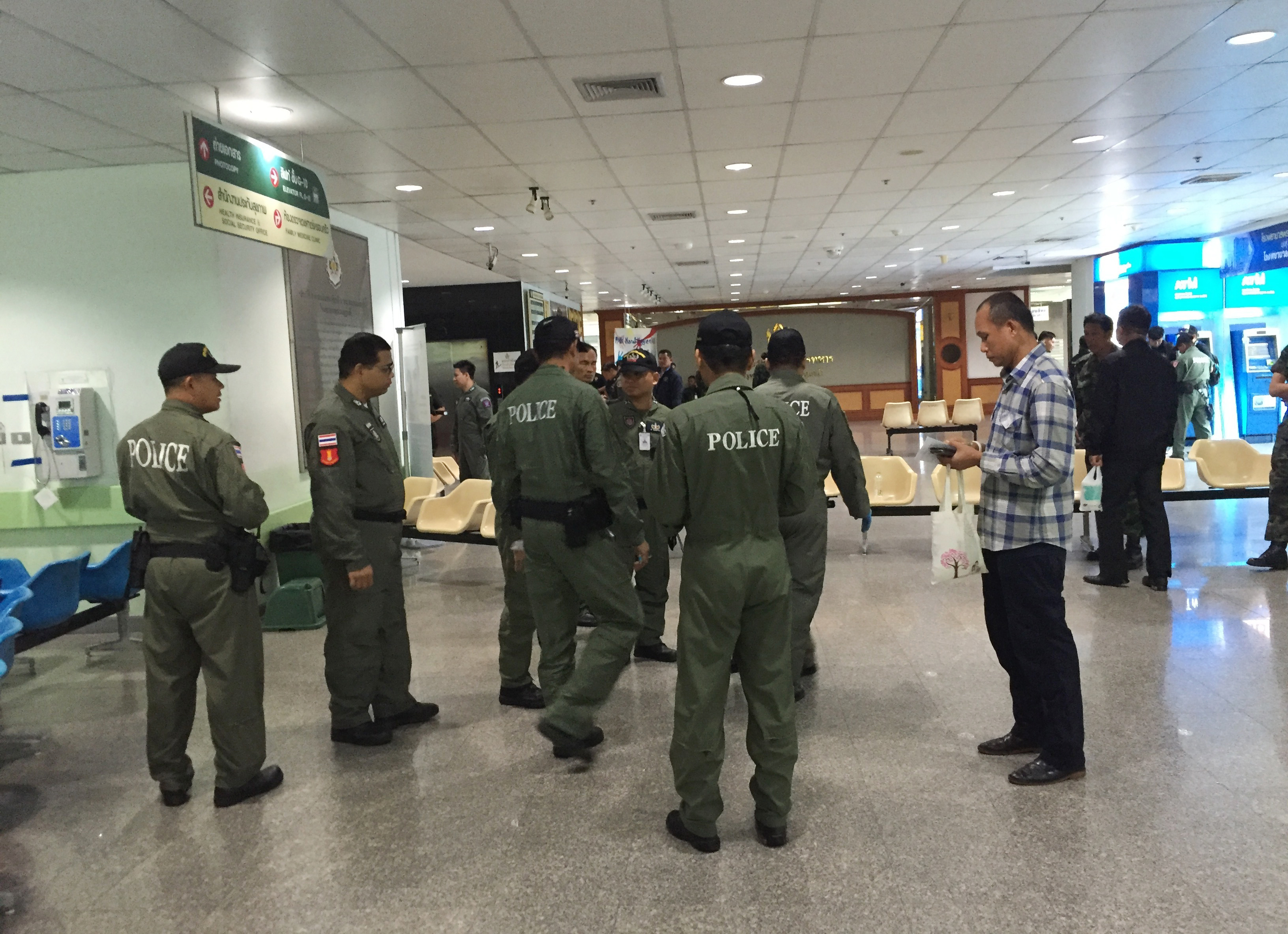 Police investigators work the lobby of Phramongkutklao Hospital, a military-owned hospital that is also open to civilians, in Bangkok after a bomb wounded more than 20 people, on May 22, 2017.