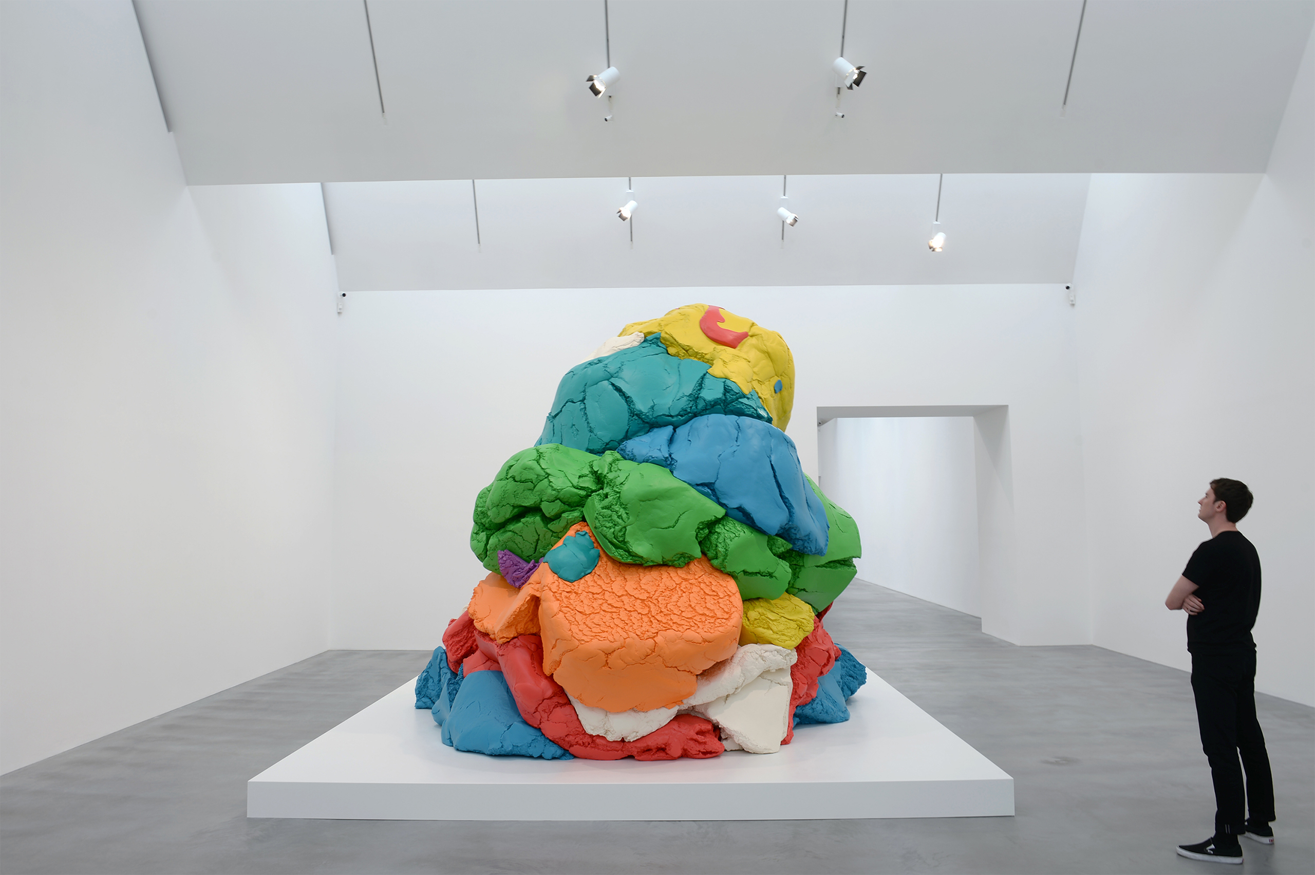 A man views Jeff Koons' sculpture  Play-Doh 1994-2014  during the opening of the Newport Street Gallery's new exhibition,  Jeff Koons: Now  in London, UK on May 17, 2016.