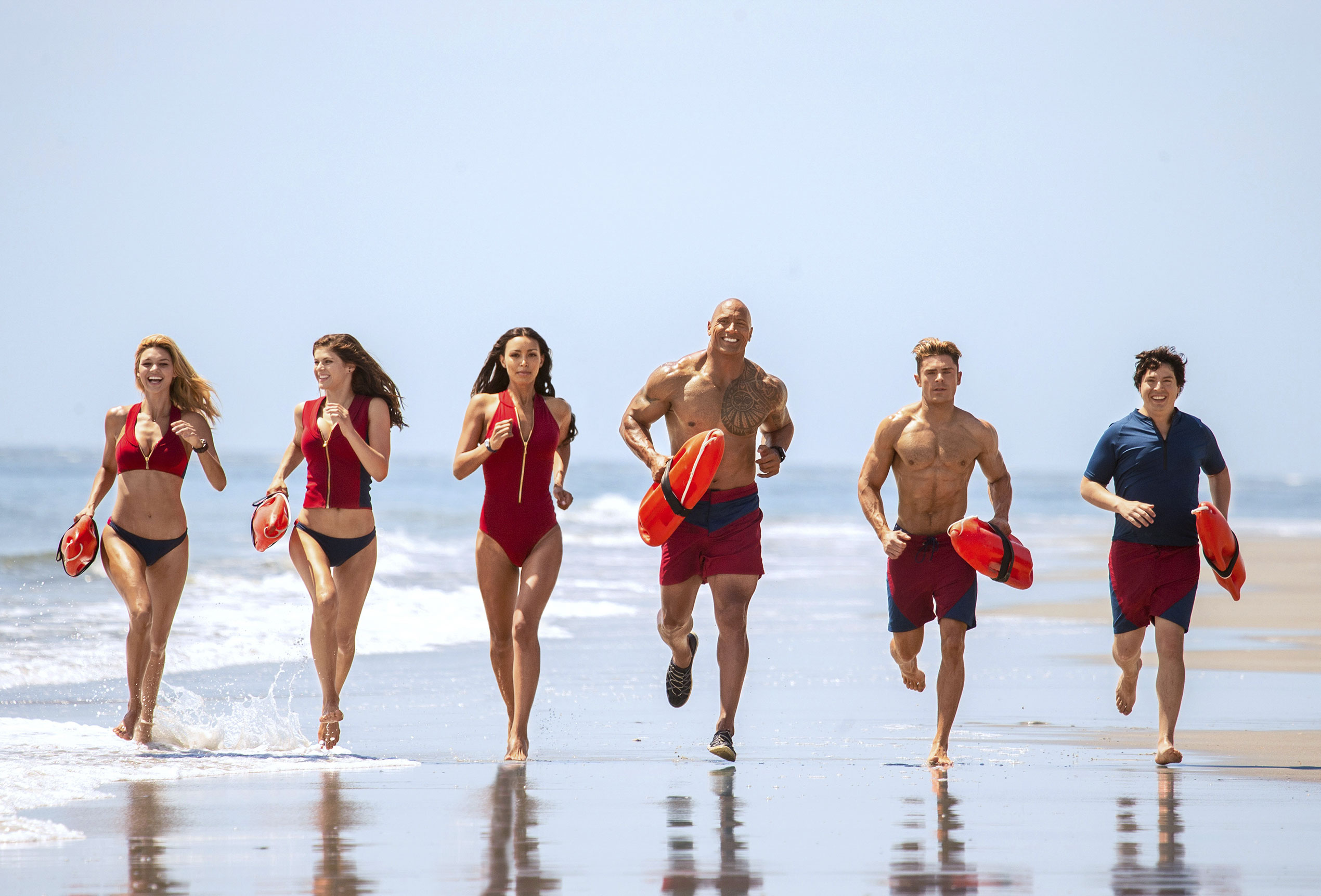 Keying off the '90s show it's based on, Baywatch keeps its hunks and lovelies trotting in slo-mo