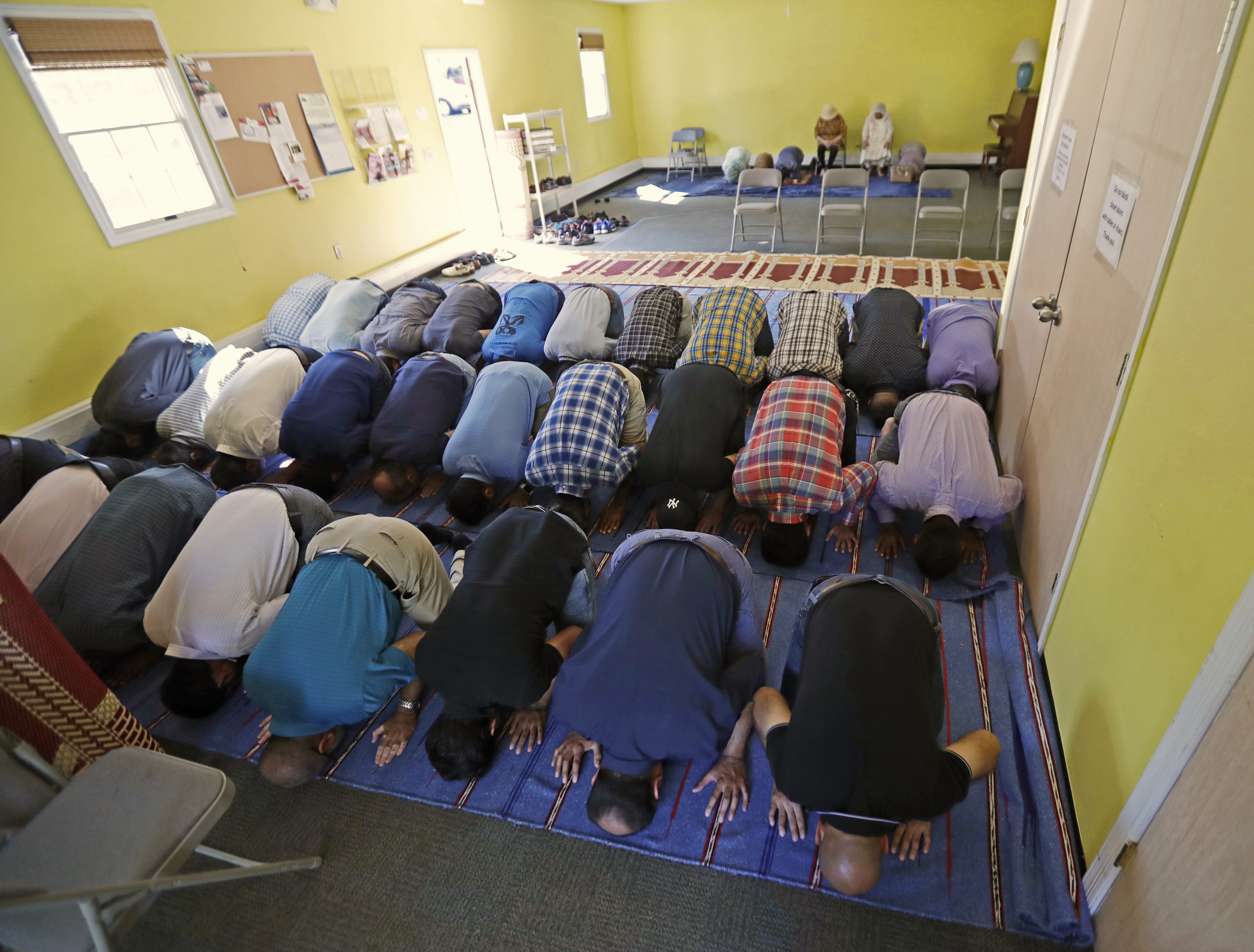 In this Sept. 23, 2016, file photo, Muslim worshippers pray during a service at the Bernards Township Community Center in Basking Ridge, N.J.