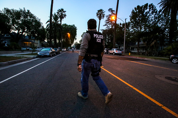 An ICE Enforcement and Removal Operations agent, on his way to raid and apprehend an immigrant without legal status in Riverside, Calif. on Aug.                      12, 2015.