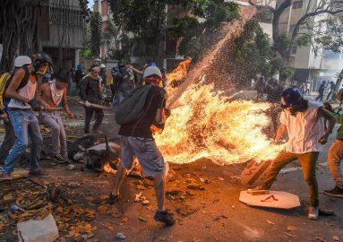 The gas tank of a police motorbike explodes during a protest in Caracas on May 3, 2017.