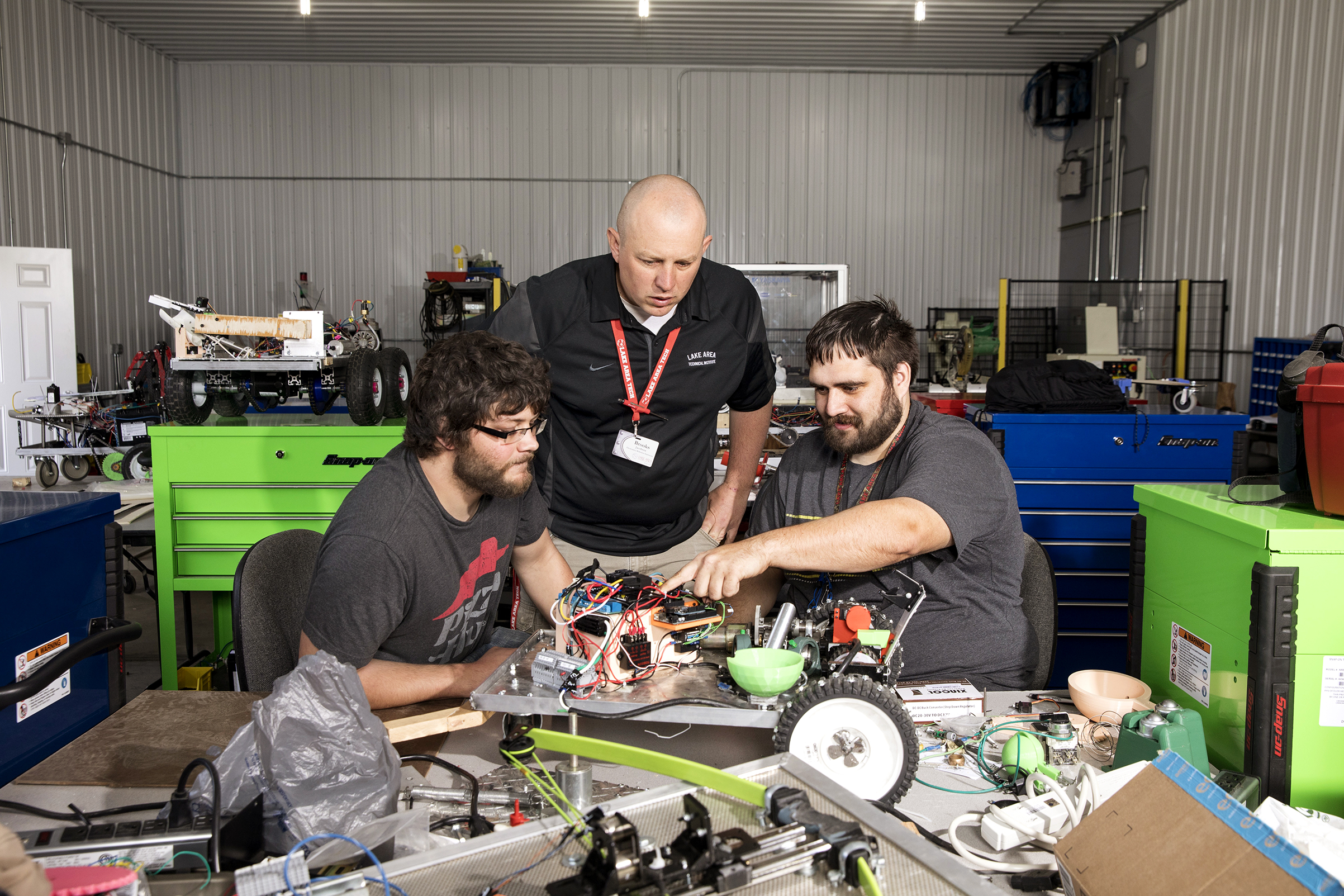 LATI instructor Brooks Jacobsen works with students in the school's robotics lab