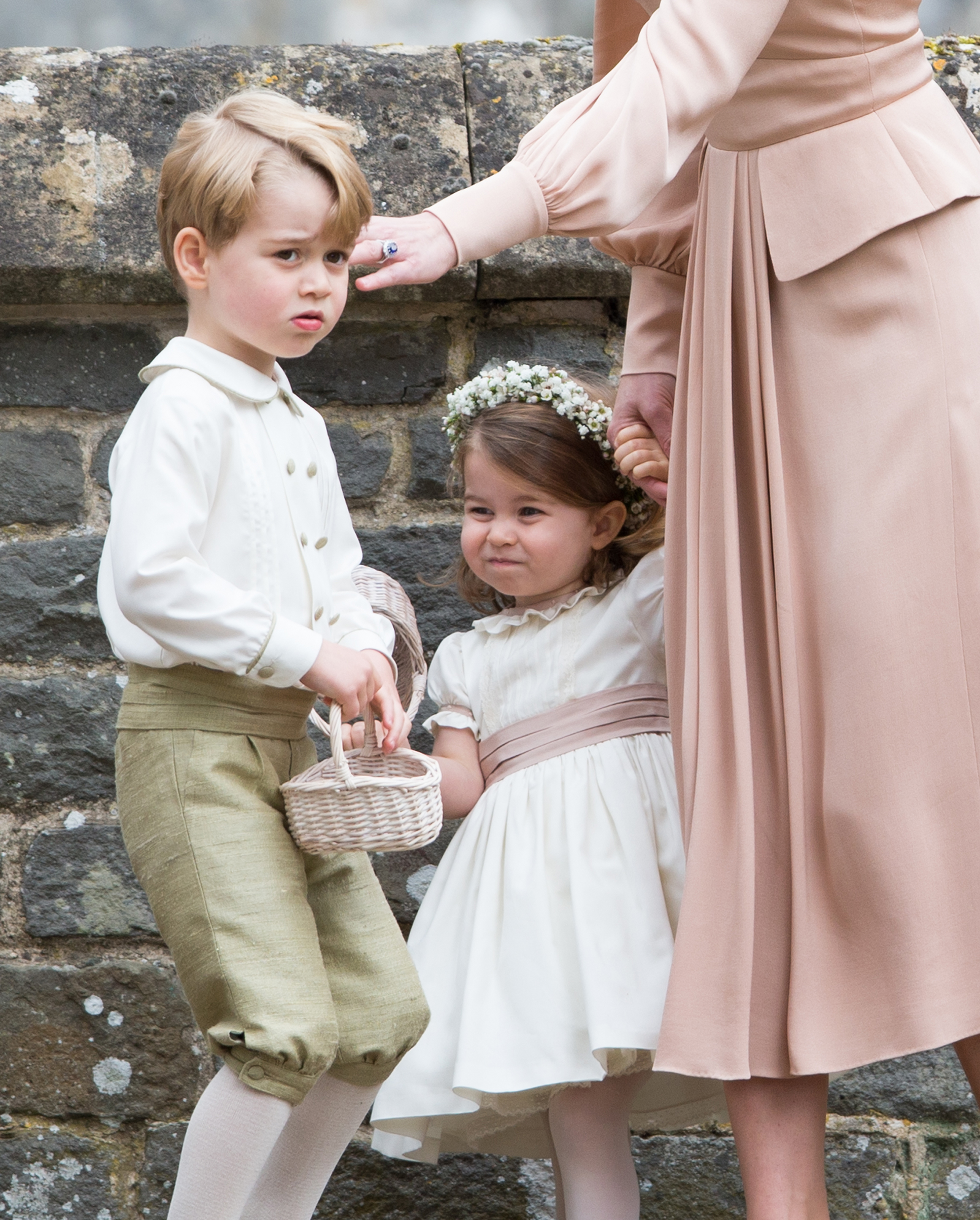 Princess Charlotte of Cambridge, bridesmaid, and Prince George of Cambridge attend the wedding Of Pippa Middleton and James Matthews at St Mark's Church on May 20, 2017 in Englefield Green, England.