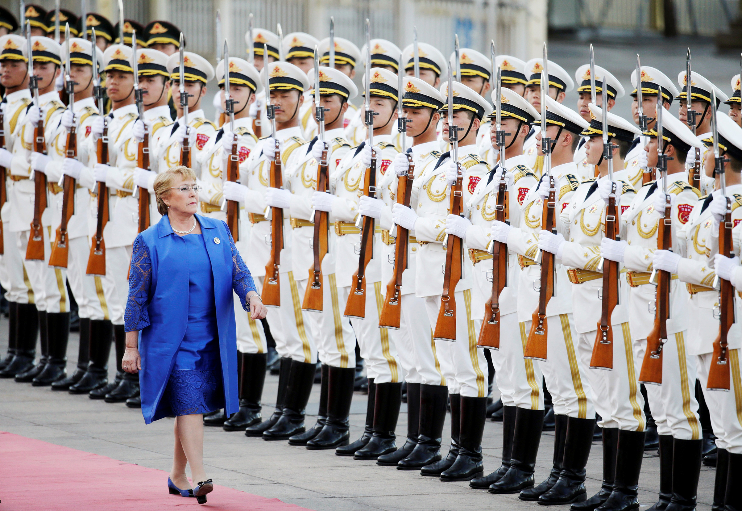 Chilean President Michelle Bachelet reviews the honour guard at a welcoming ceremony ahead of the Belt and Road Forum in Beijing, China May 13, 2017.