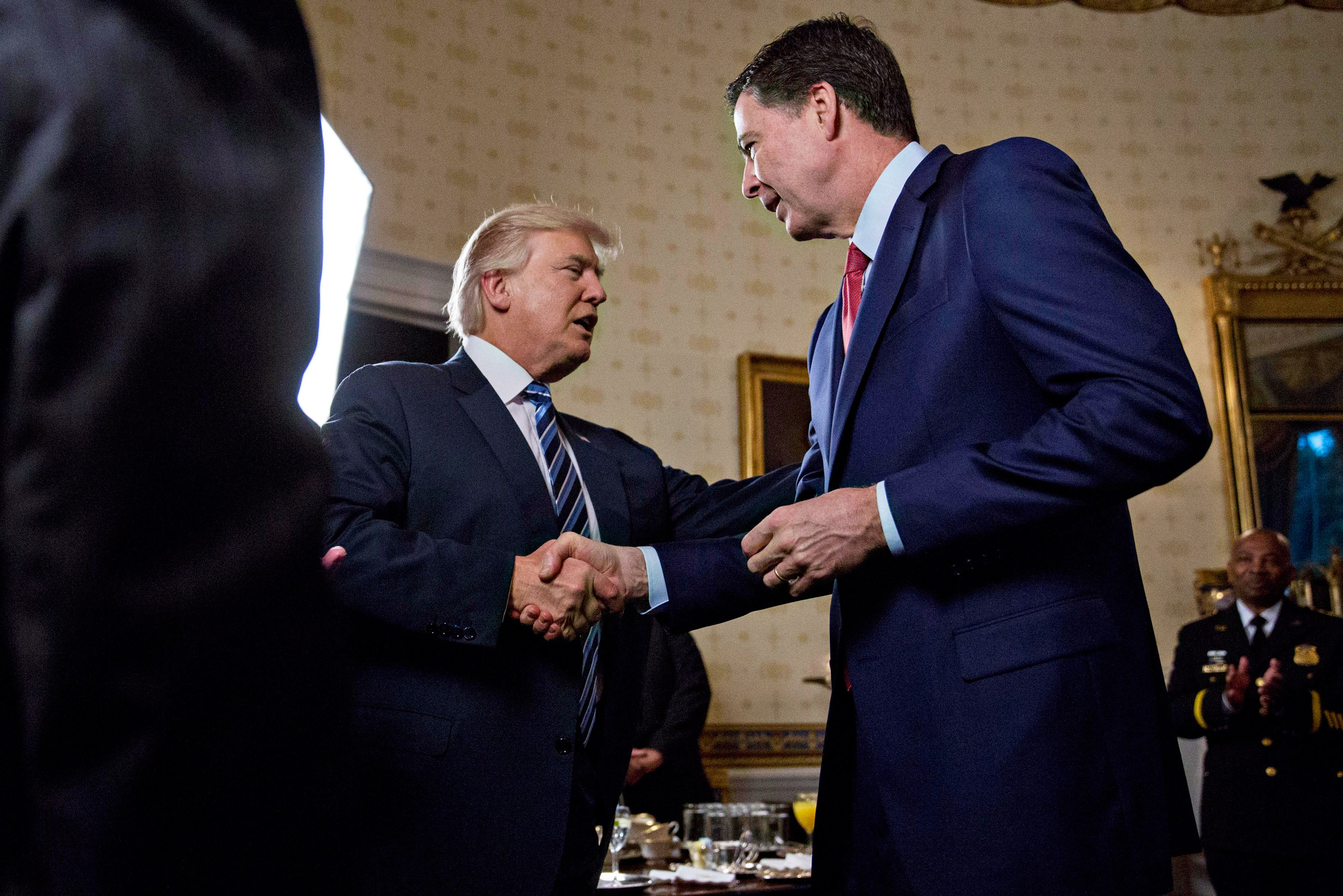 President Trump shook hands with Comey during an Inaugural reception at the White House in January