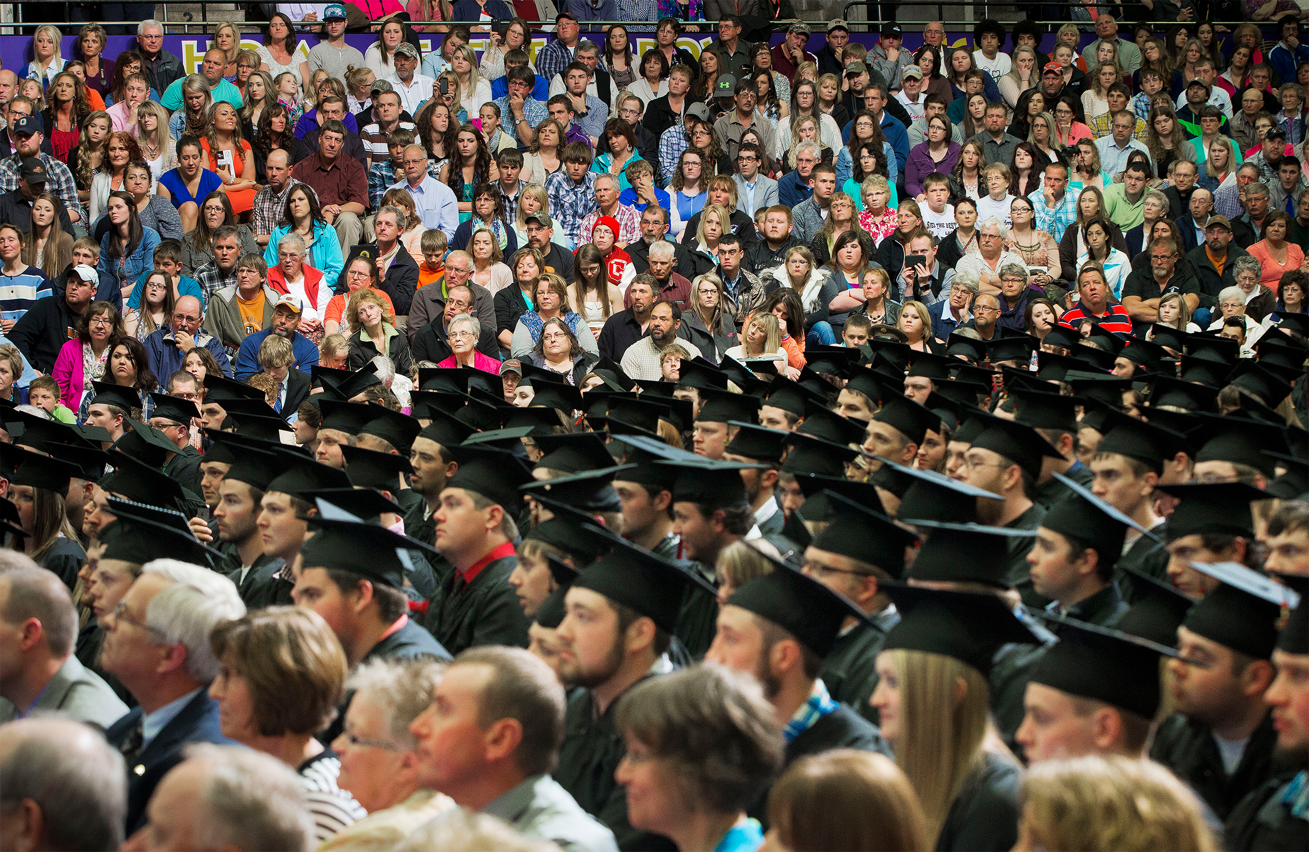 Graduates, faculty and guest in the audience listen to President Barack Obama deliver the commencement address at Lake Area Technical Institute, Friday, May 8, 2015 in Watertown, SD.